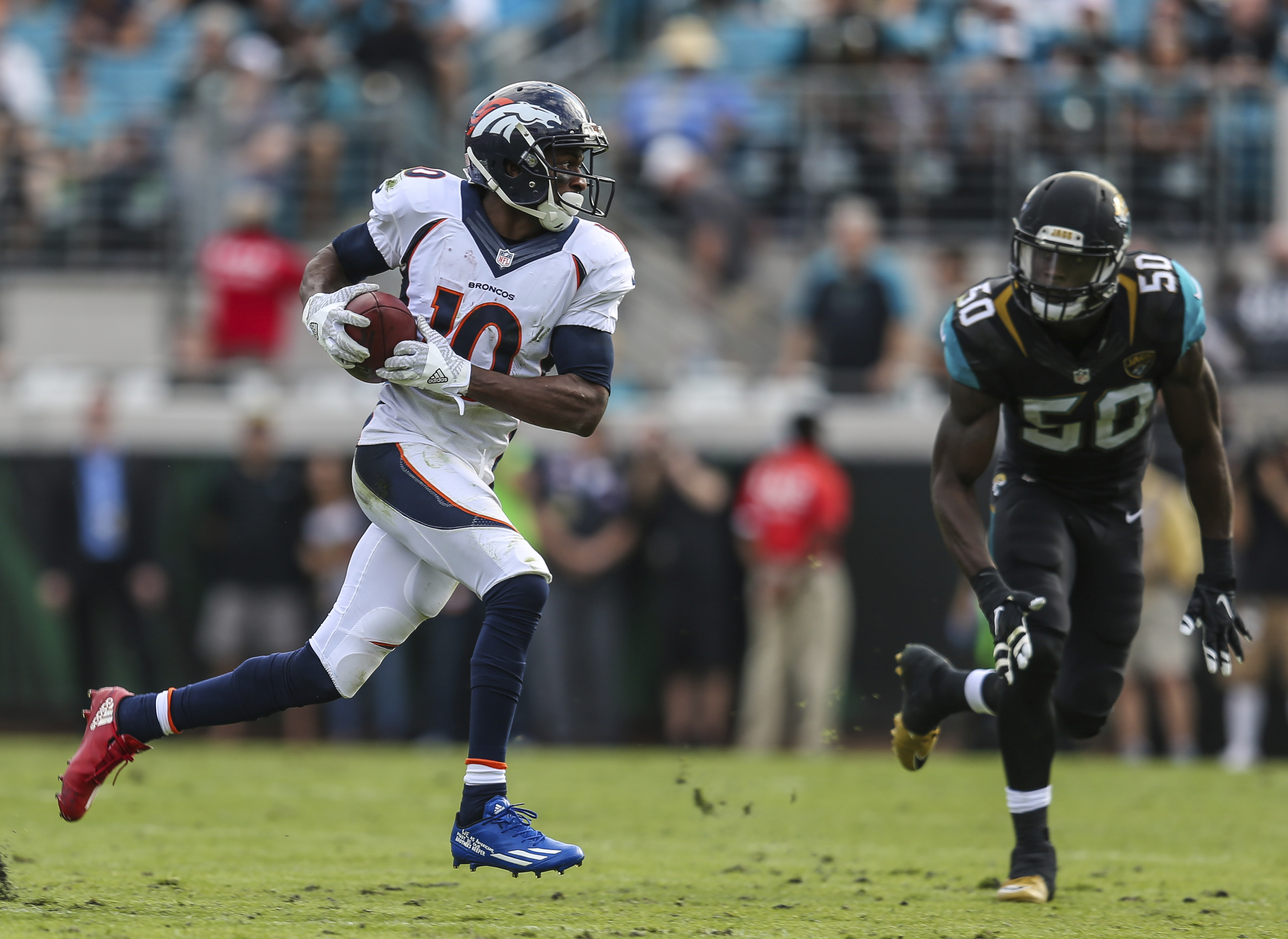 FILE - In this Dec. 4, 2016, file photo, Denver Broncos wide receiver Emmanuel Sanders (10) runs the ball defended by Jacksonville Jaguars outside linebacker Telvin Smith (50) during the second half of an NFL football game, in Jacksonville, Fla. Gary Kubi