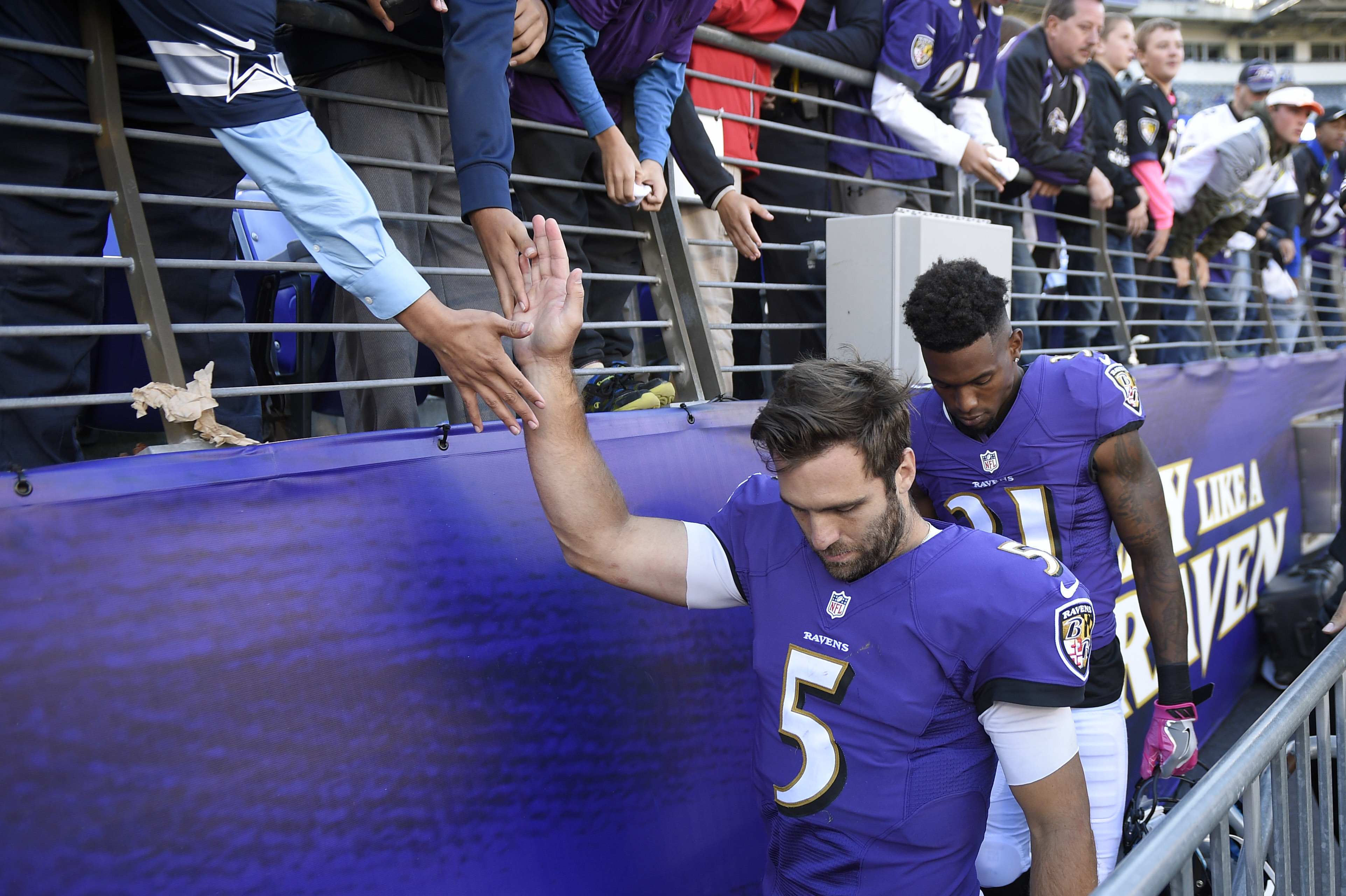 FILE - In this Oct. 9, 2016, file photo, Baltimore Ravens' Joe Flacco greets fans as he walks to the locker room after losing an NFL football game to the Washington Redskins, in Baltimore.  It's been an inconsistent season for Ravens quarterback Joe Flacc