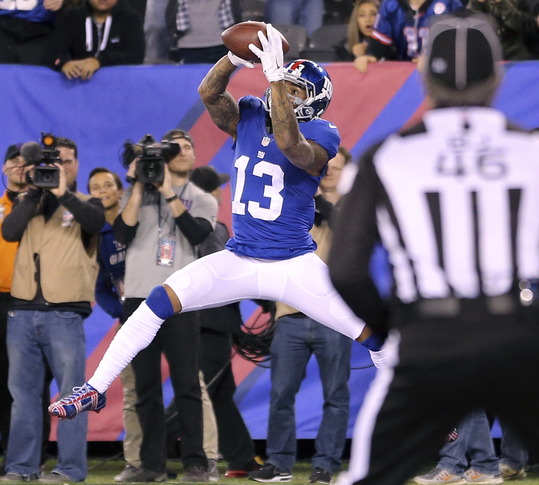 FILE - In this Nov. 14, 2016, file photo, New York Giants wide receiver Odell Beckham Jr. (13) catches a touchdown pass against the Cincinnati Bengals during the second quarter of an NFL football game, in East Rutherford, N.J. There's plenty at stake when
