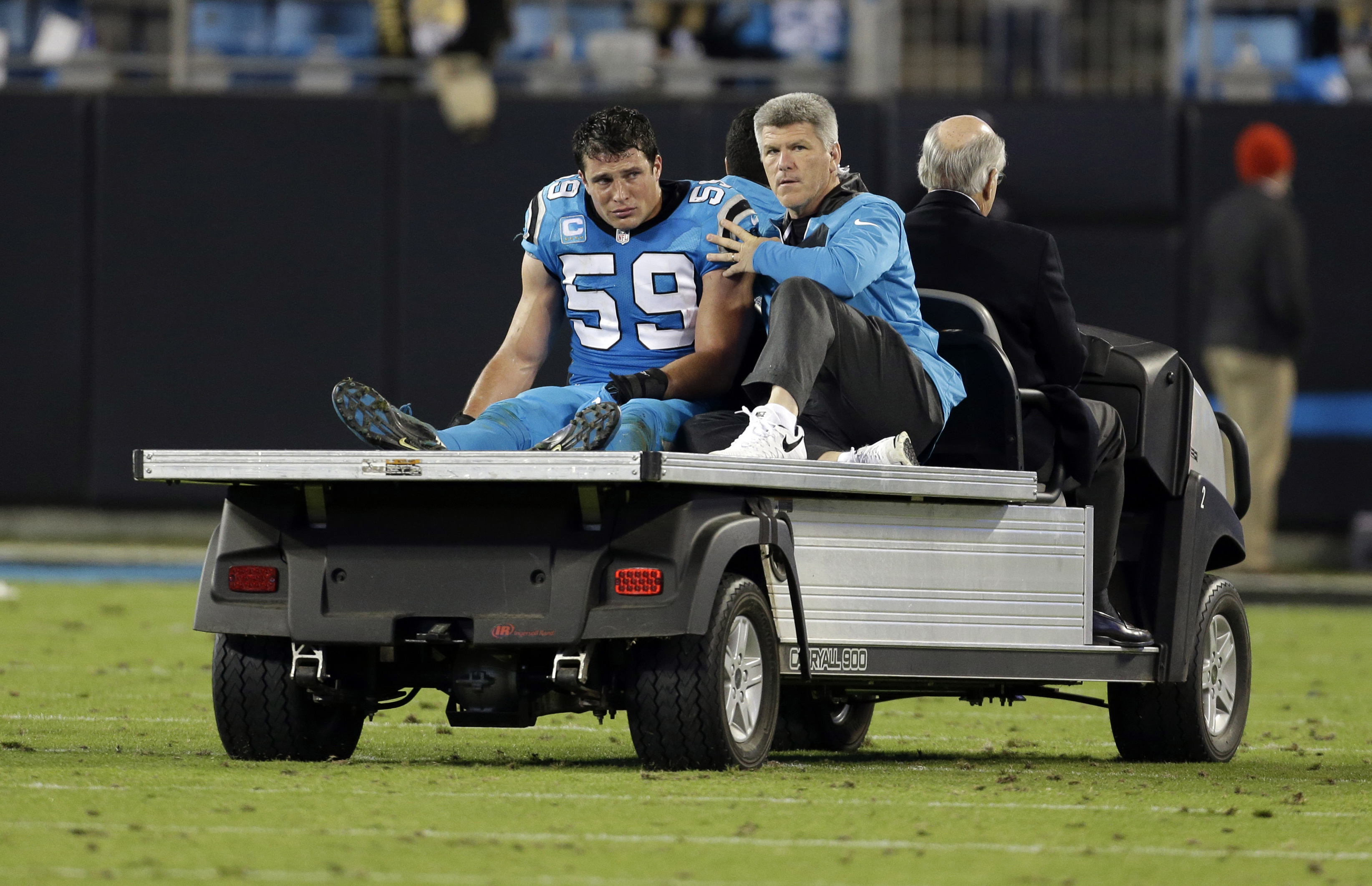 FILE - In this Nov. 17, 2016, file photo, Carolina Panthers linebacker Luke Kuechly (59) is taken off the field after being injured in the second half of an NFL football game against the New Orleans Saints, in Charlotte, N.C. While Kuechly desperately wan