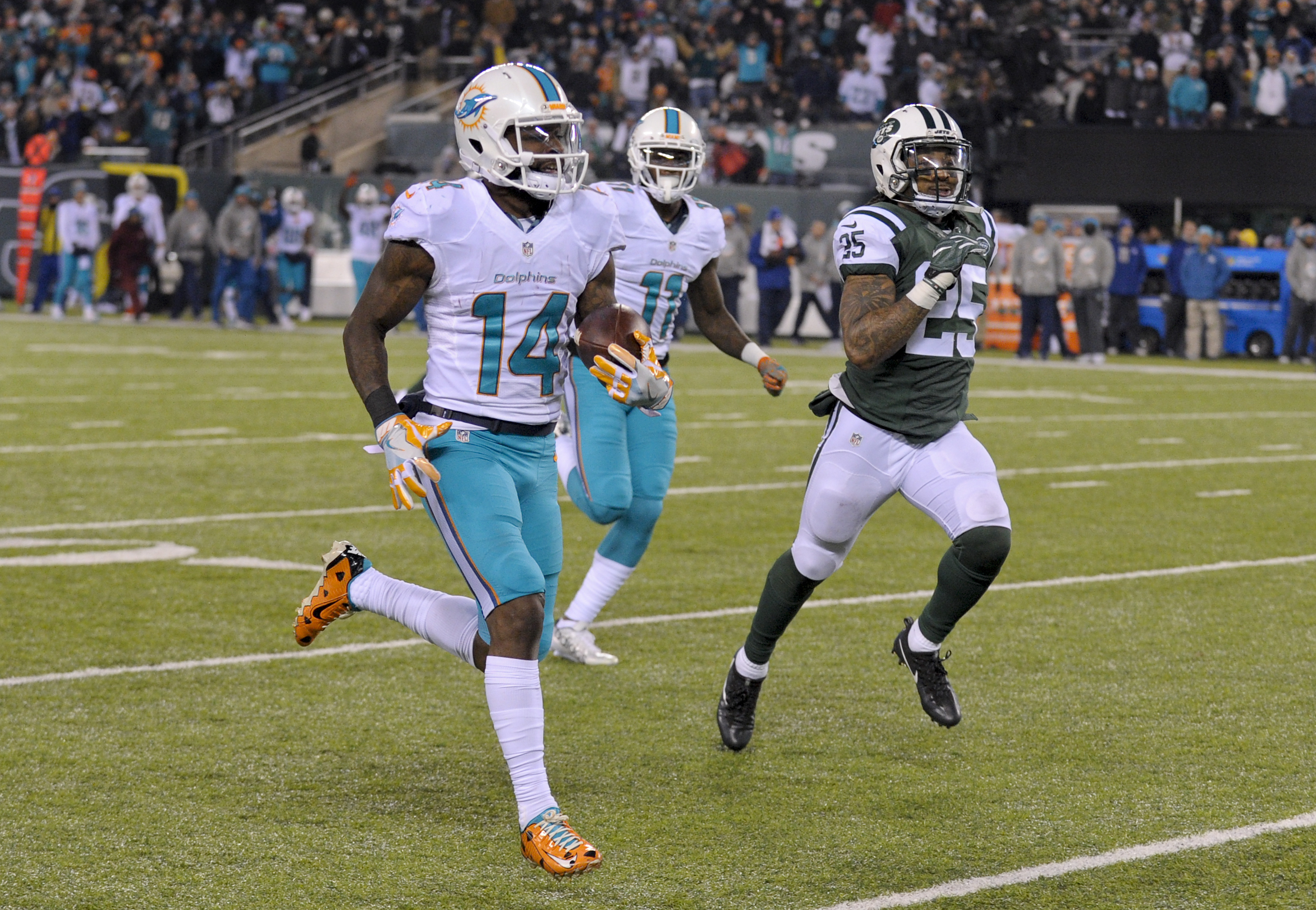 FILE - In this Dec. 17, 2016, file photo, Miami Dolphins wide receiver Jarvis Landry (14) runs for a touchdown against the New York Jets during an NFL football game in East Rutherford, N.J. Landry prepares to play Saturday, Dec. 24, against the Buffalo Bi