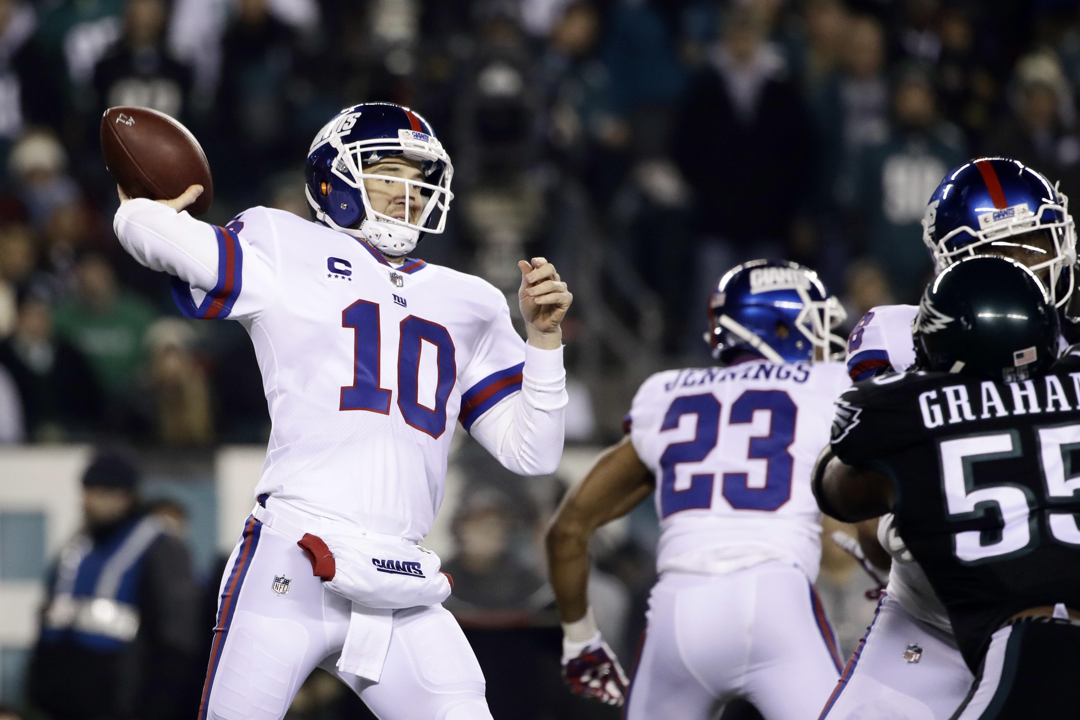New York Giants' Eli Manning passes during the first half of an NFL football game against the Philadelphia Eagles, Thursday, Dec. 22, 2016, in Philadelphia. (AP Photo/Matt Rourke)