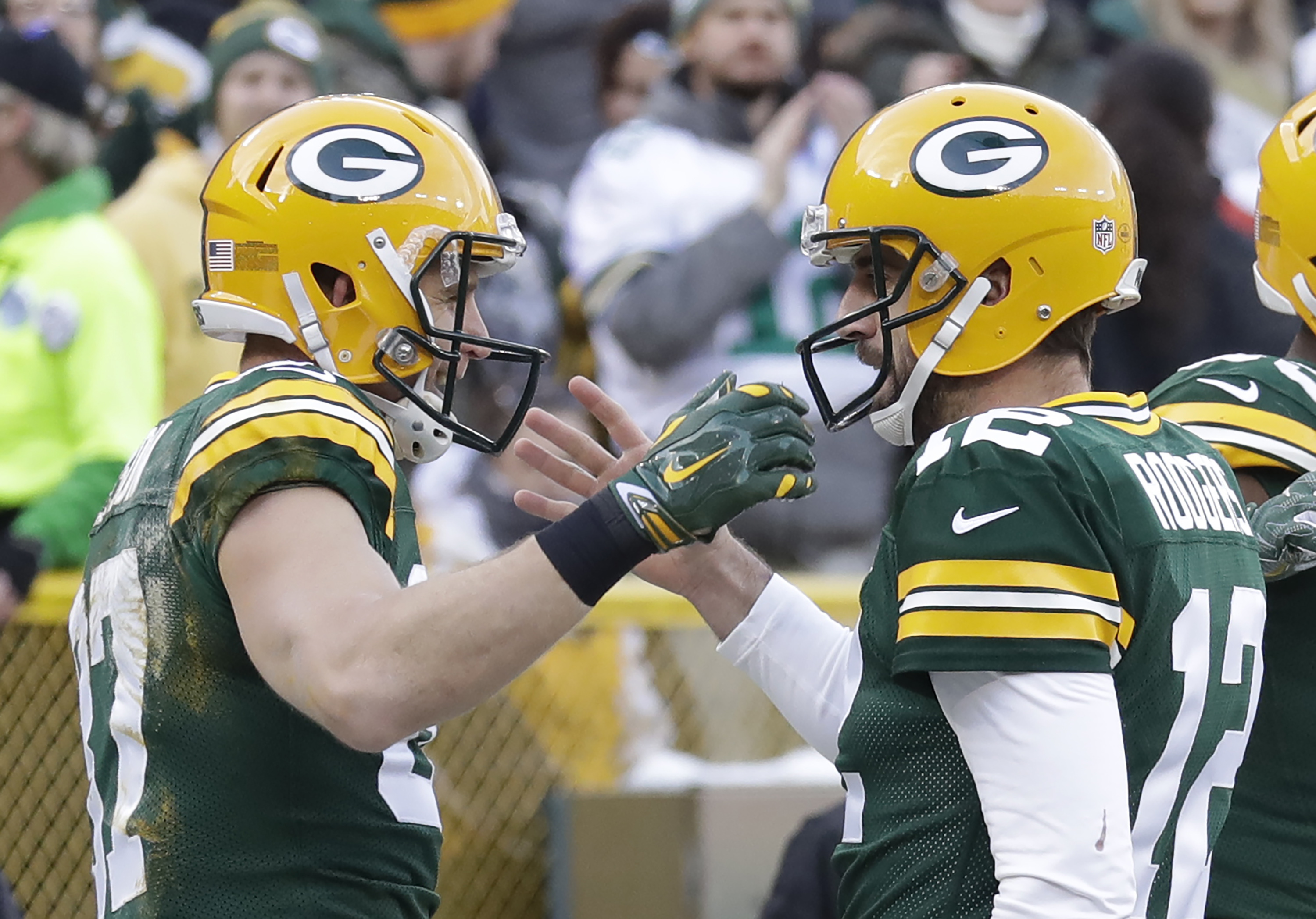 Green Bay Packers' Jordy Nelson celebrates his touchdown catch with Aaron Rodgers during the first half of an NFL football game against the Minnesota Vikings Saturday, Dec. 24, 2016, in Green Bay, Wis. (AP Photo/Morry Gash)