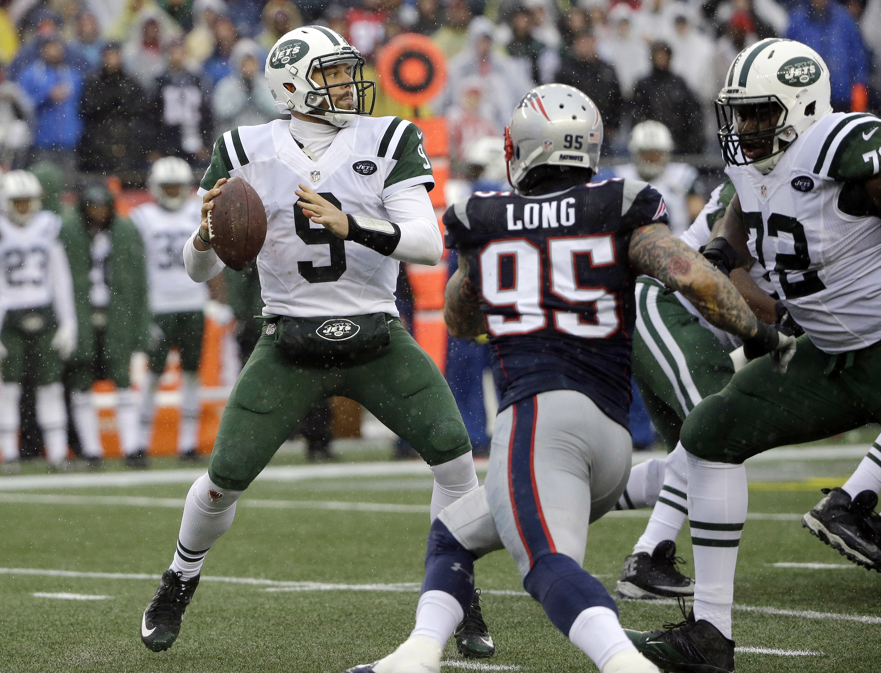 New York Jets quarterback Bryce Petty (9) looks for a receiver under pressure from New England Patriots defensive end Chris Long (95) during the first half of an NFL football game, Saturday, Dec. 24, 2016, in Foxborough, Mass. (AP Photo/Elise Amendola)