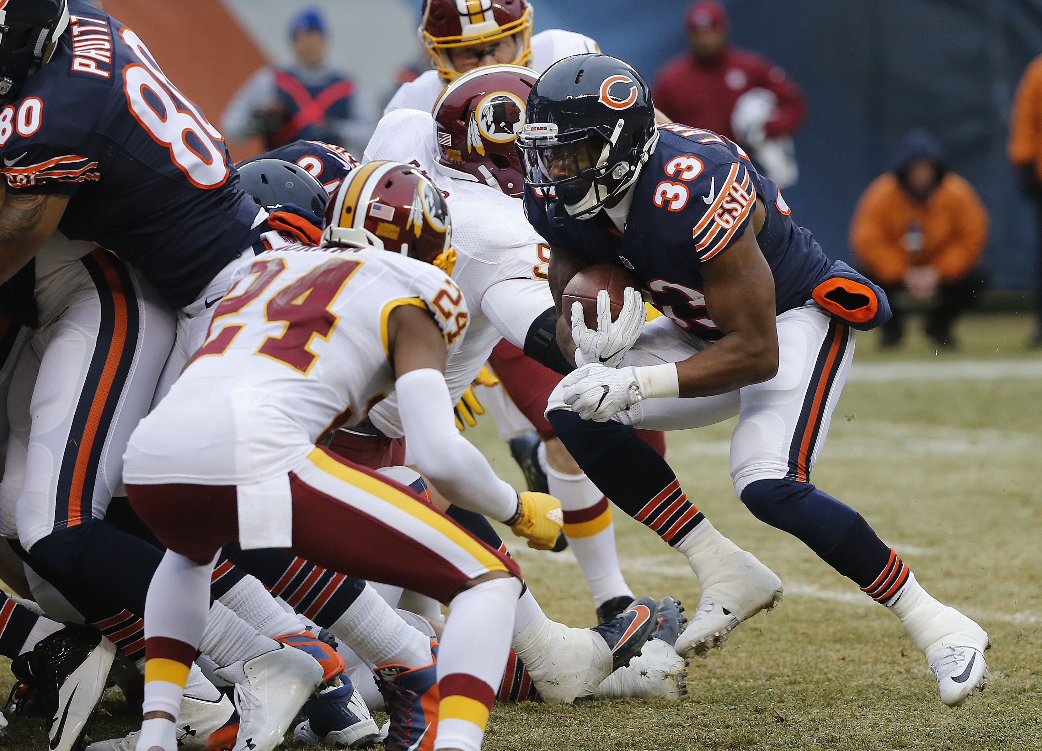 Chicago Bears running back Jeremy Langford (33) scores on a one-yard touchdown run against the Washington Redskins during the first half of an NFL football game, Saturday, Dec. 24, 2016, in Chicago. (AP Photo/Charles Rex Arbogast)