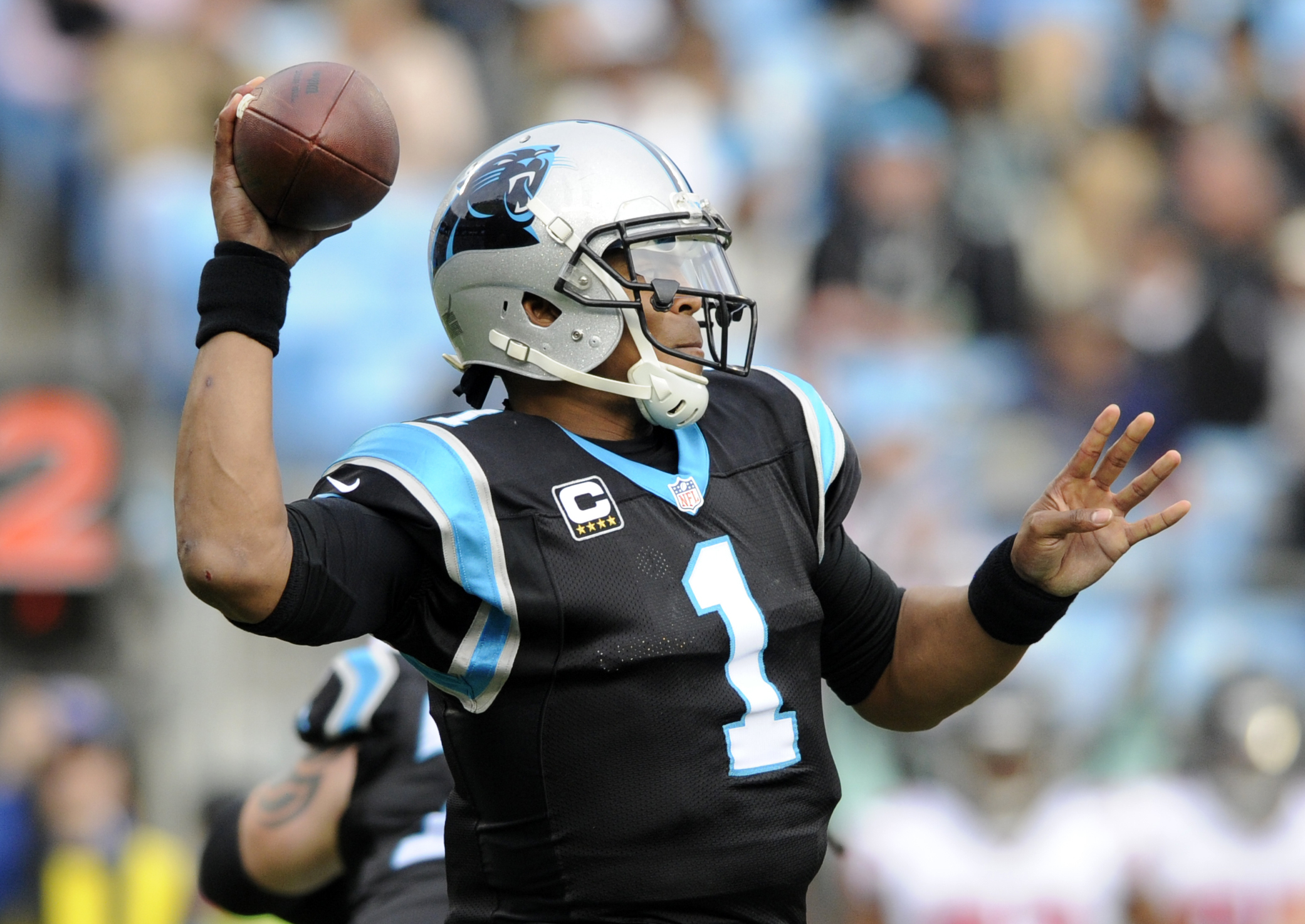 Carolina Panthers' Cam Newton (1) looks to pass against the Atlanta Falcons in the second half of an NFL football game in Charlotte, N.C., Saturday, Dec. 24, 2016. (AP Photo/Mike McCarn)