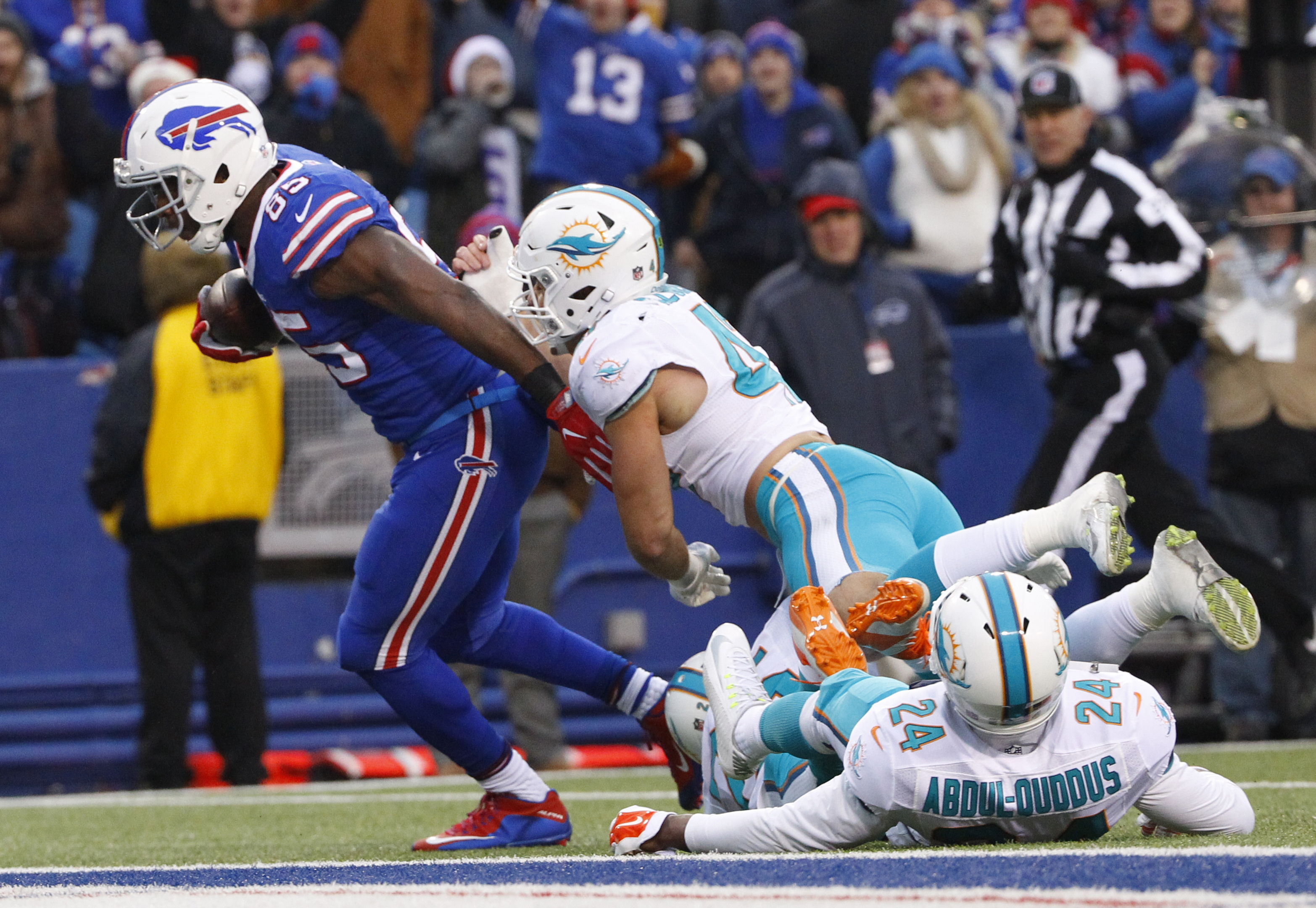 Buffalo Bills tight end Charles Clay (85) breaks a tackle by Miami Dolphins' Kiko Alonso (47) to score a touchdown as Isa Abdul-Quddus (24) watches during the second half of an NFL football game, Saturday, Dec. 24, 2016, in Orchard Park, N.Y. (AP Photo/Bi