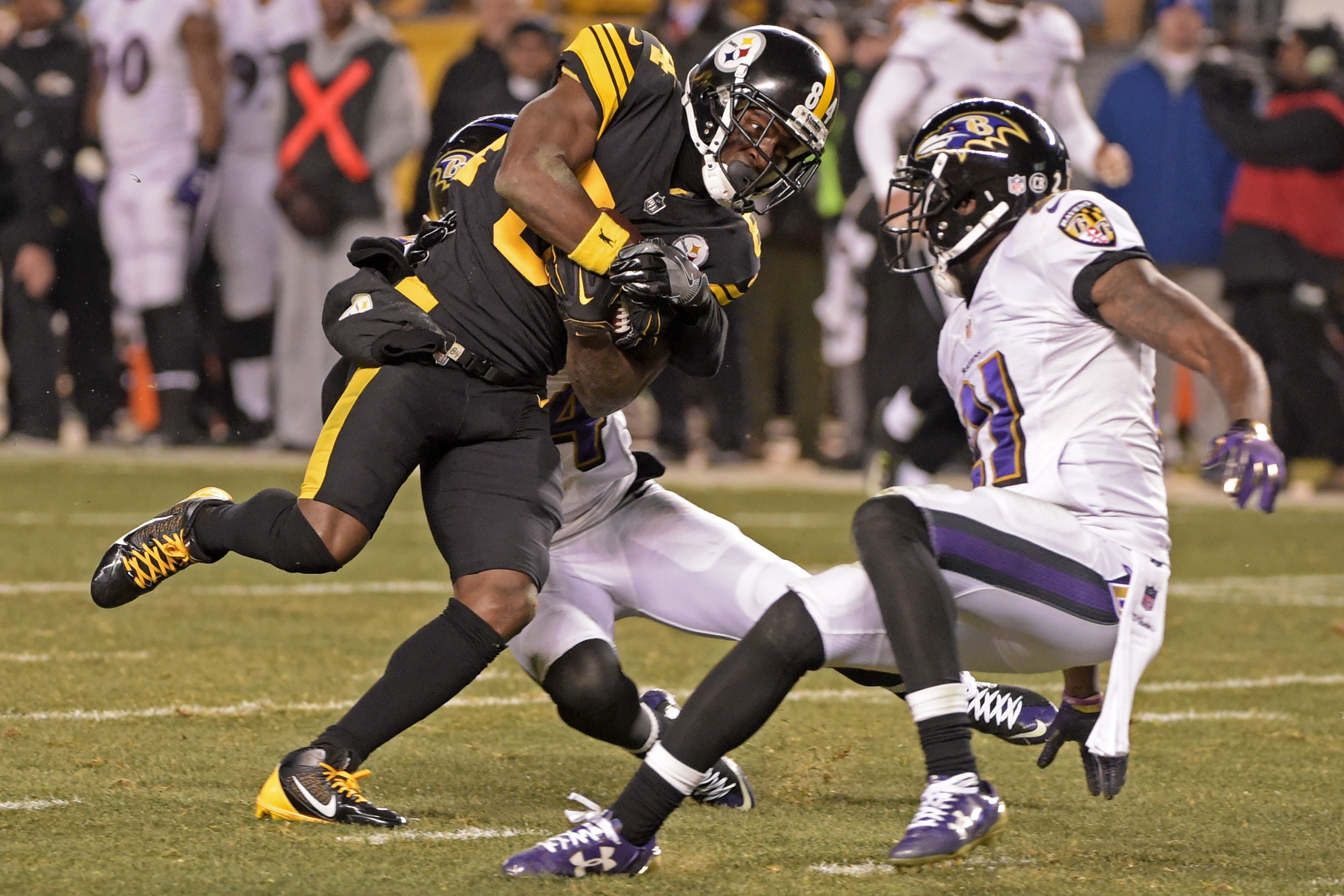 Pittsburgh Steelers wide receiver Antonio Brown (84) is tackled by Baltimore Ravens cornerback Kyle Arrington (24) after making a catch during the second half of an NFL football game in Pittsburgh, Sunday, Dec. 25, 2016. (AP Photo/Fred Vuich)