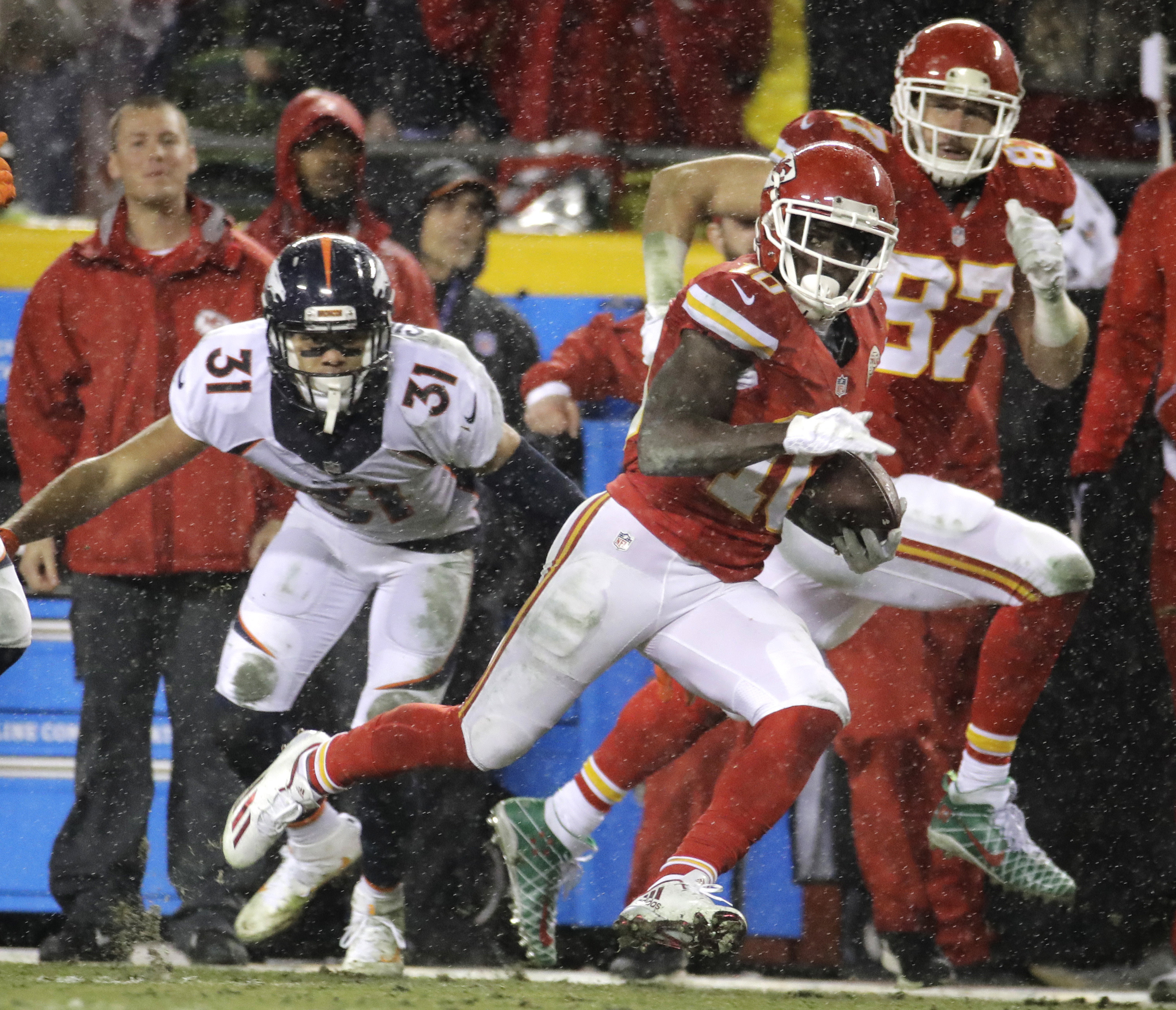 Kansas City Chiefs wide receiver Tyreek Hill (10) runs past Denver Broncos safety Justin Simmons (31) for a 70-yard touchdown, with tight end Travis Kelce (87) running alongside him during the first half of an NFL football game against the Denver Broncos