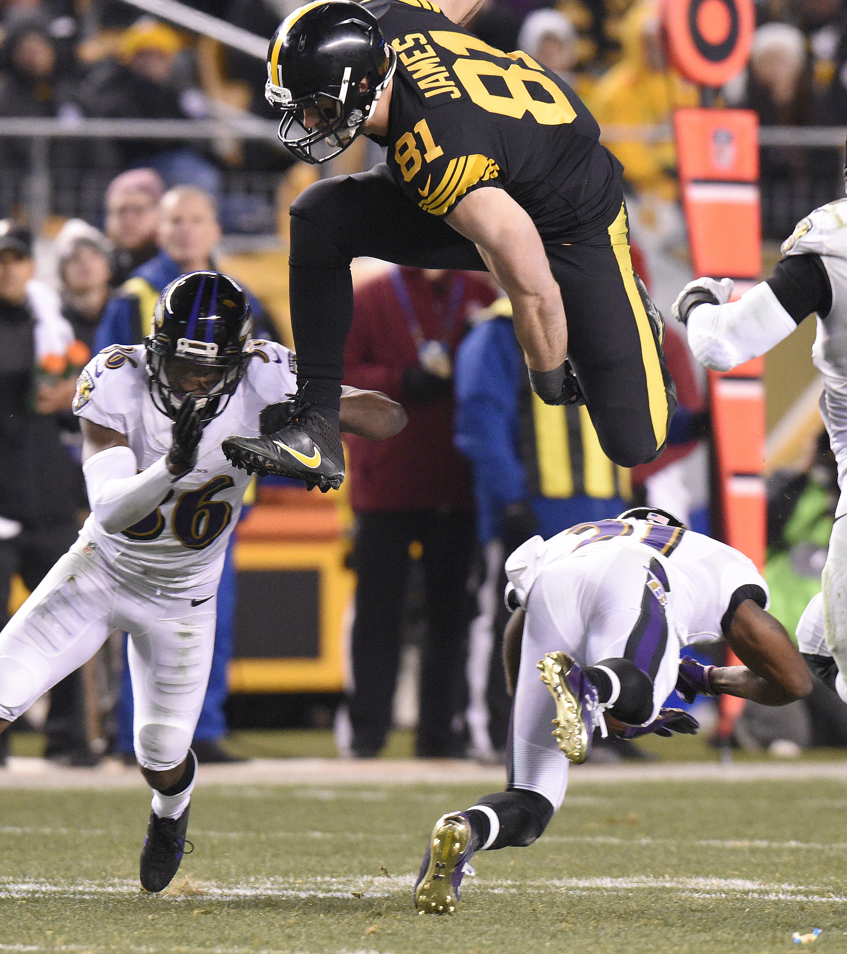 FILE - In this Sunday, Dec. 25, 2016, file photo, Pittsburgh Steelers tight end Jesse James (81) leaps over Baltimore Ravens cornerback Chris Lewis-Harris (31) before being tackled by cornerback Tavon Young (36) during the second half of an NFL football g