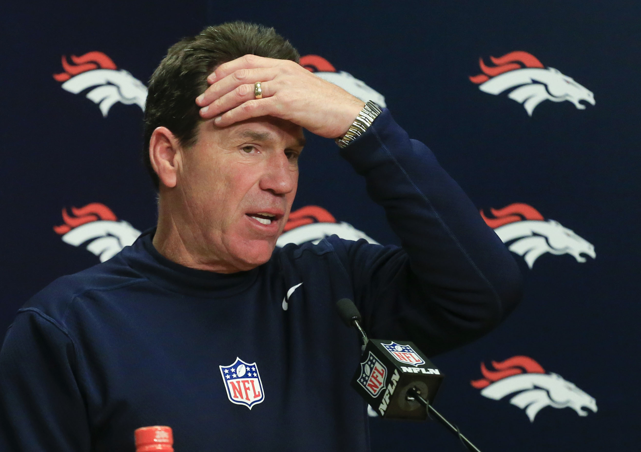 FILE - In a Sunday, Dec. 18, 2016 file photo, Denver Broncos head coach Gary Kubiak talks during a news conference after their loss against the New England Patriots in an NFL football game, in Denver. Denver's five-year playoff run that featured two Super