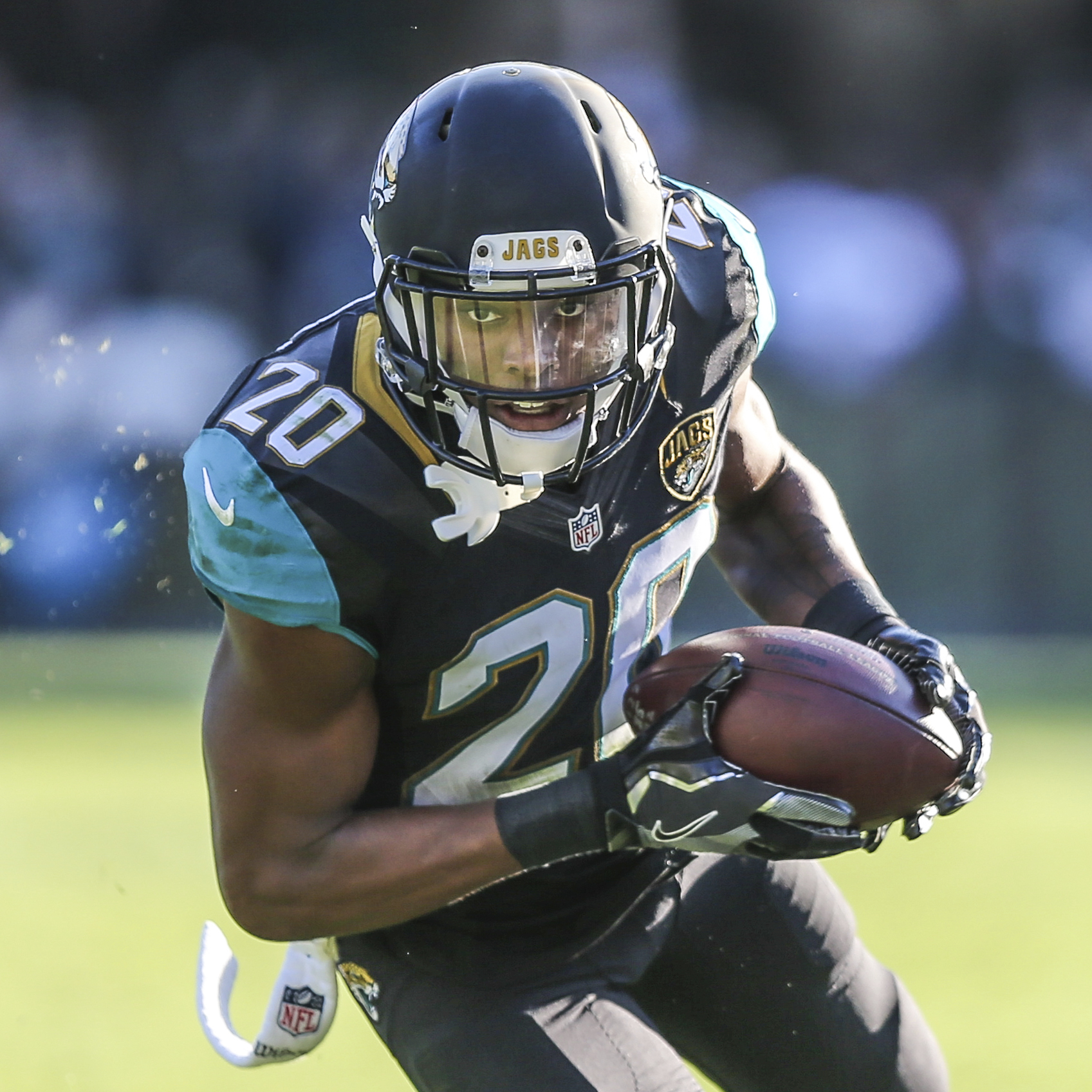 CORRECTS SECOND REFERENCE - In this Saturday, Dec. 24, 2016, photo, Jacksonville Jaguars cornerback Jalen Ramsey returns an interception for a touchdown against the Tennessee Titans during the second half of an NFL football game in Jacksonville, Fla. Rams