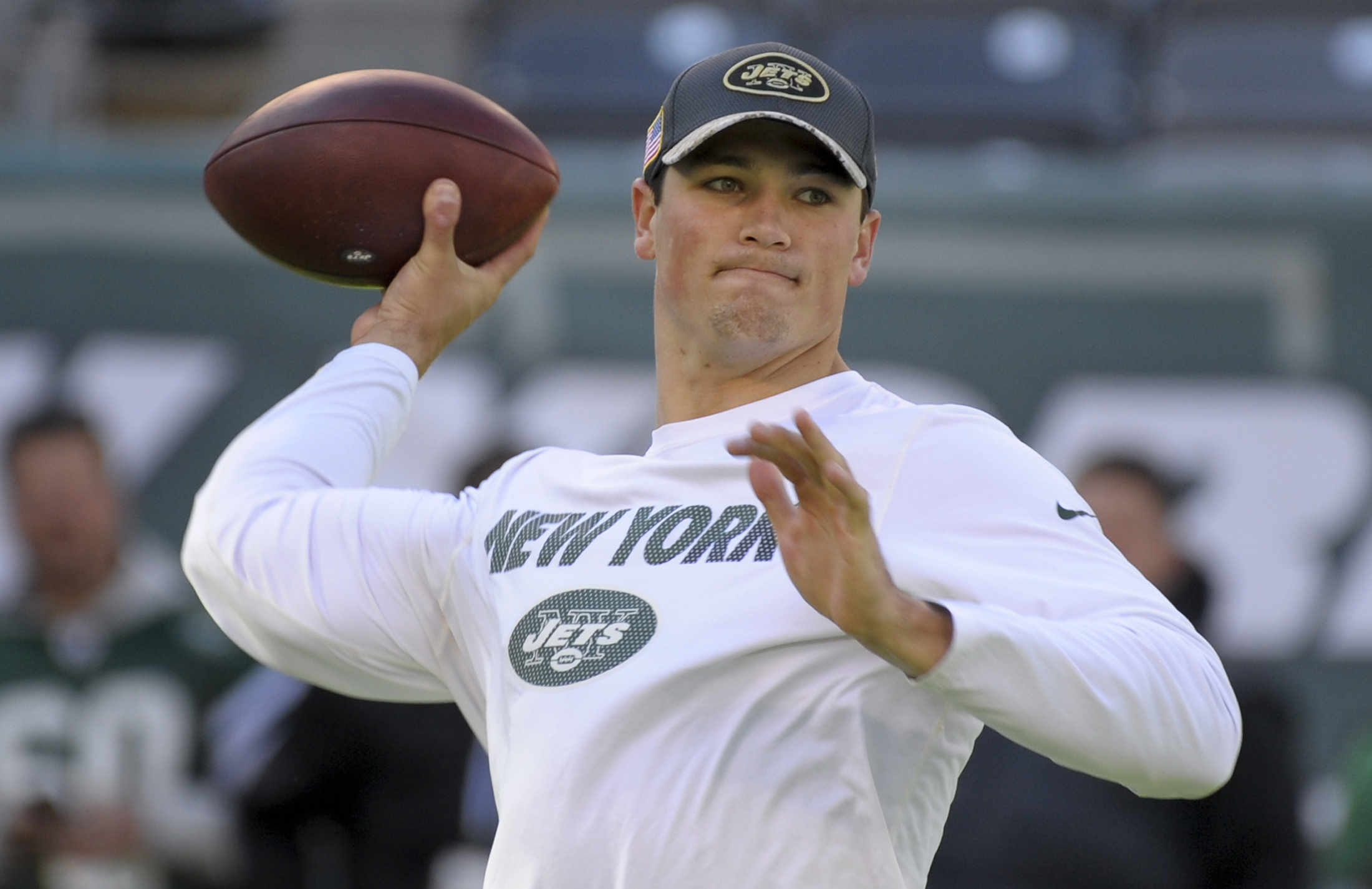 FILE - In this Nov. 13, 2016, file photo, New York Jets quarterback Christian Hackenberg throws a pass before the team's NFL football game against the Los Angeles Rams in East Rutherford, N.J. Hackenberg will swap his sweats for shoulder pads and a helmet