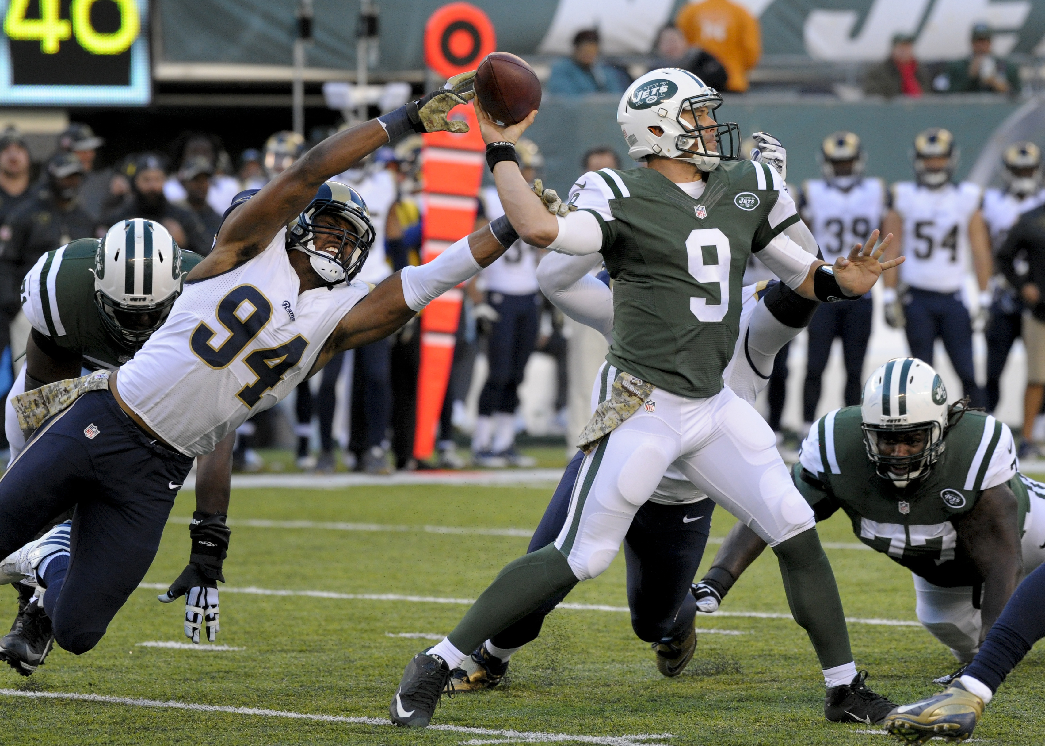FILE - In a Sunday, Nov. 13, 2016 file photo, New York Jets quarterback Bryce Petty (9) throws under pressure from Los Angeles Rams defensive end Robert Quinn (94) during the third quarter of an NFL football game, in East Rutherford, N.J. Los Angeles won