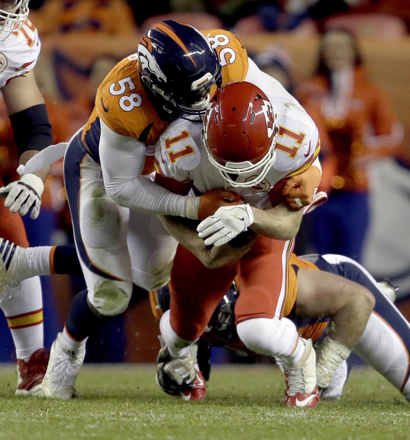 FILE - In a Sunday, Nov. 27, 2016 file photo, Kansas City Chiefs quarterback Alex Smith (11) is sacked by Denver Broncos outside linebacker Von Miller (58) during the first half of an NFL football game, in Denver. Spoiler is an unfamiliar role for Von Mil