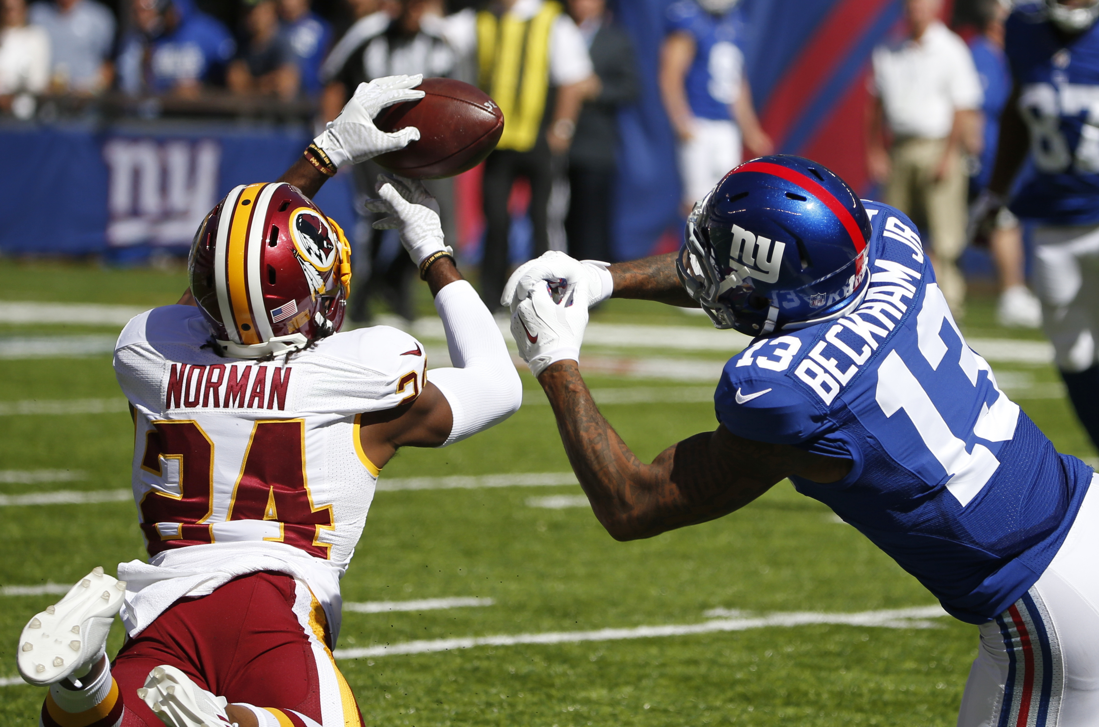 FILE - In this Sept. 25, 2016, file photo, Washington Redskins cornerback Josh Norman (24) fights for control of the ball with New York Giants' Odell Beckham Jr. (13) during the first half of an NFL football game in East Rutherford, N.J. In the final Sund