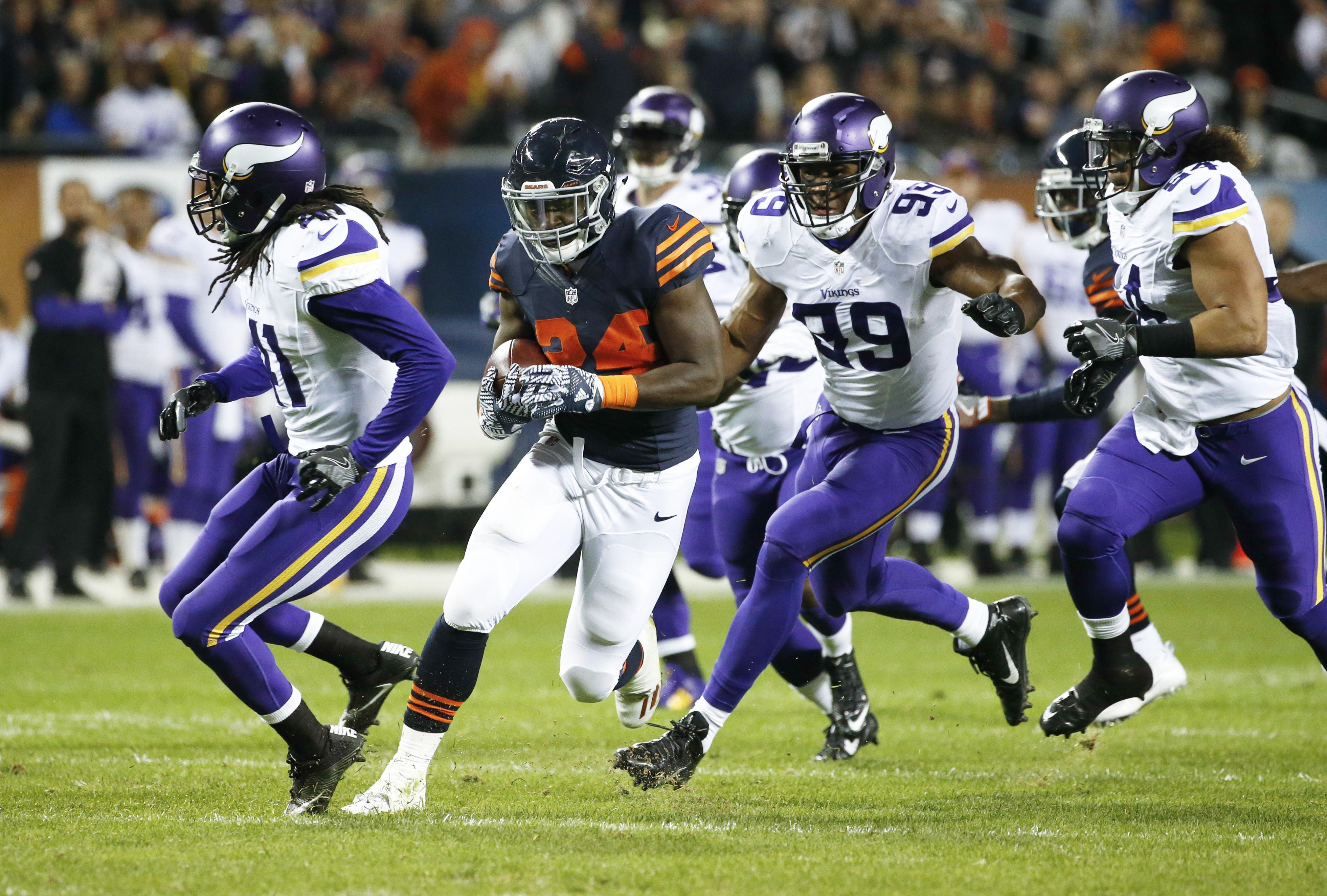 FILE - In a Monday, Oct. 31, 2016 file photo, Chicago Bears running back Jordan Howard (24) runs from Minnesota Vikings strong safety Anthony Harris, from left, Danielle Hunter (99) and Eric Kendricks (54) during the first half of an NFL football game in