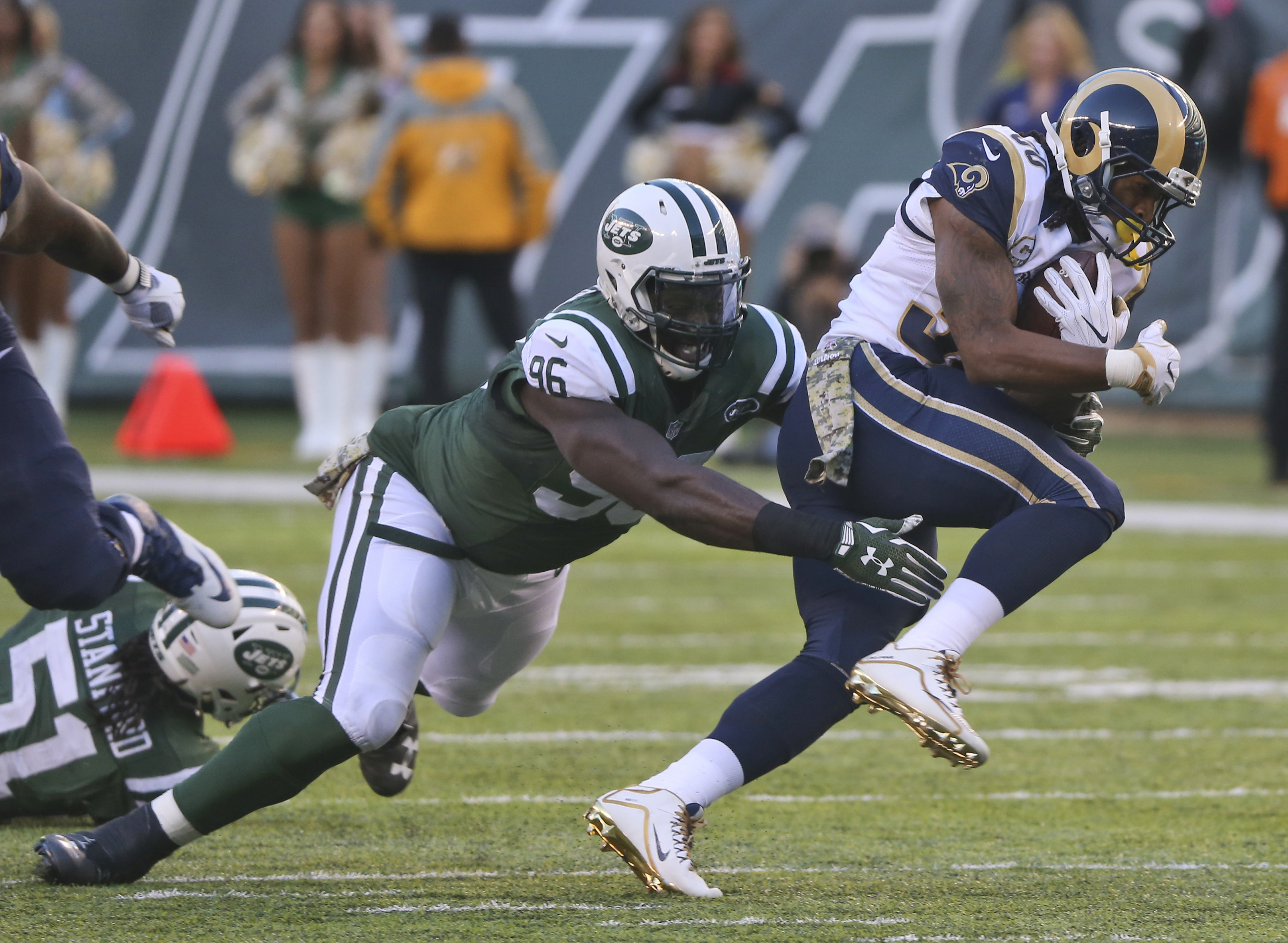 FILE - In this Nov. 13, 2016, file photo, Los Angeles Rams running back Todd Gurley (30) is tackled by New York Jets defensive end Muhammad Wilkerson (96) during an NFL football game in East Rutherford, N.J. Wilkerson knew something wasn't quite right wit