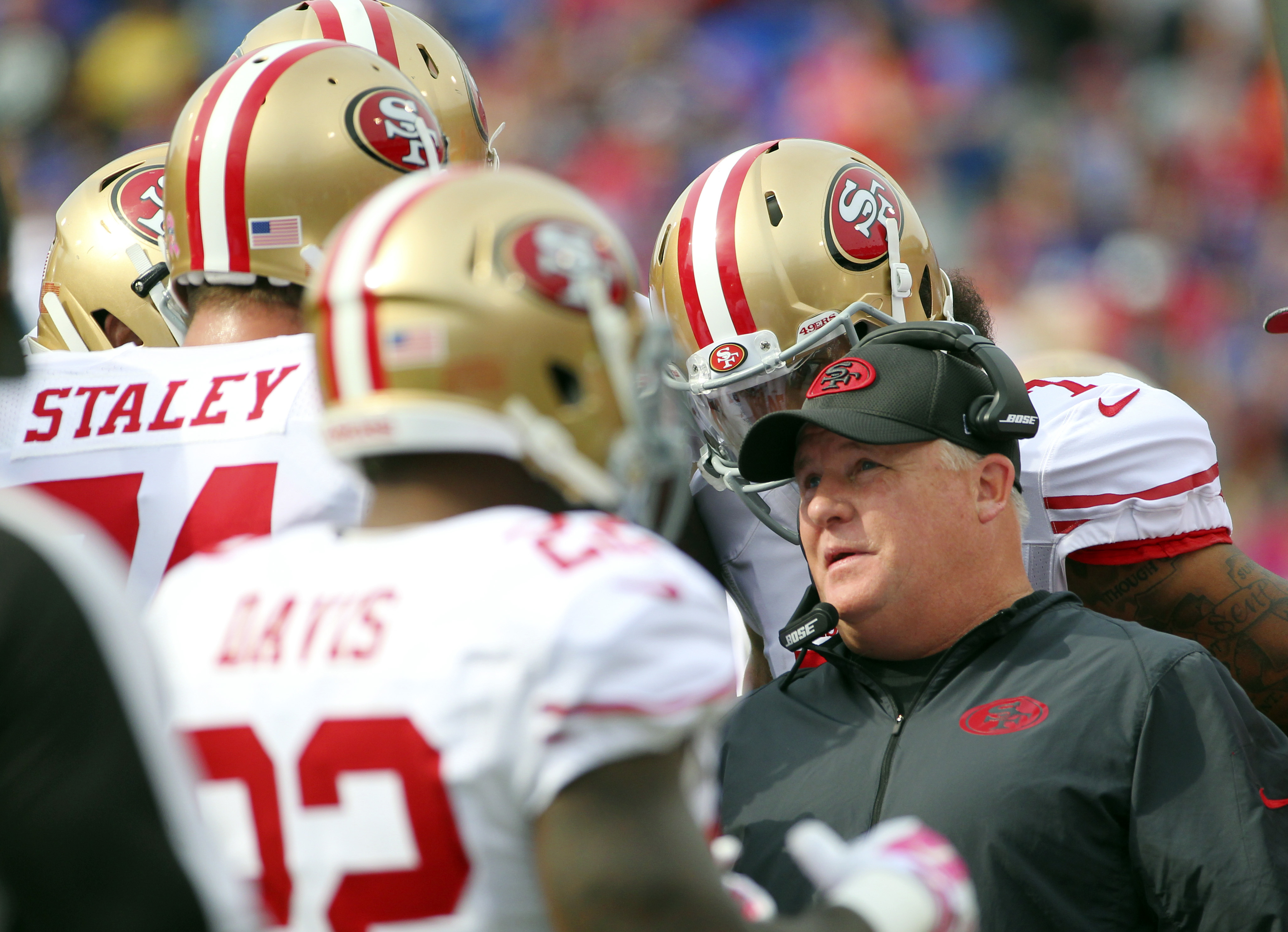FILE - In a Sunday, Oct. 16, 2016 file photo, San Francisco 49ers head coach Chip Kelly talks to his players during the first half of an NFL football game against the Buffalo Bills, in Orchard Park, N.Y. San Francisco snapped a franchise-record 13-game lo