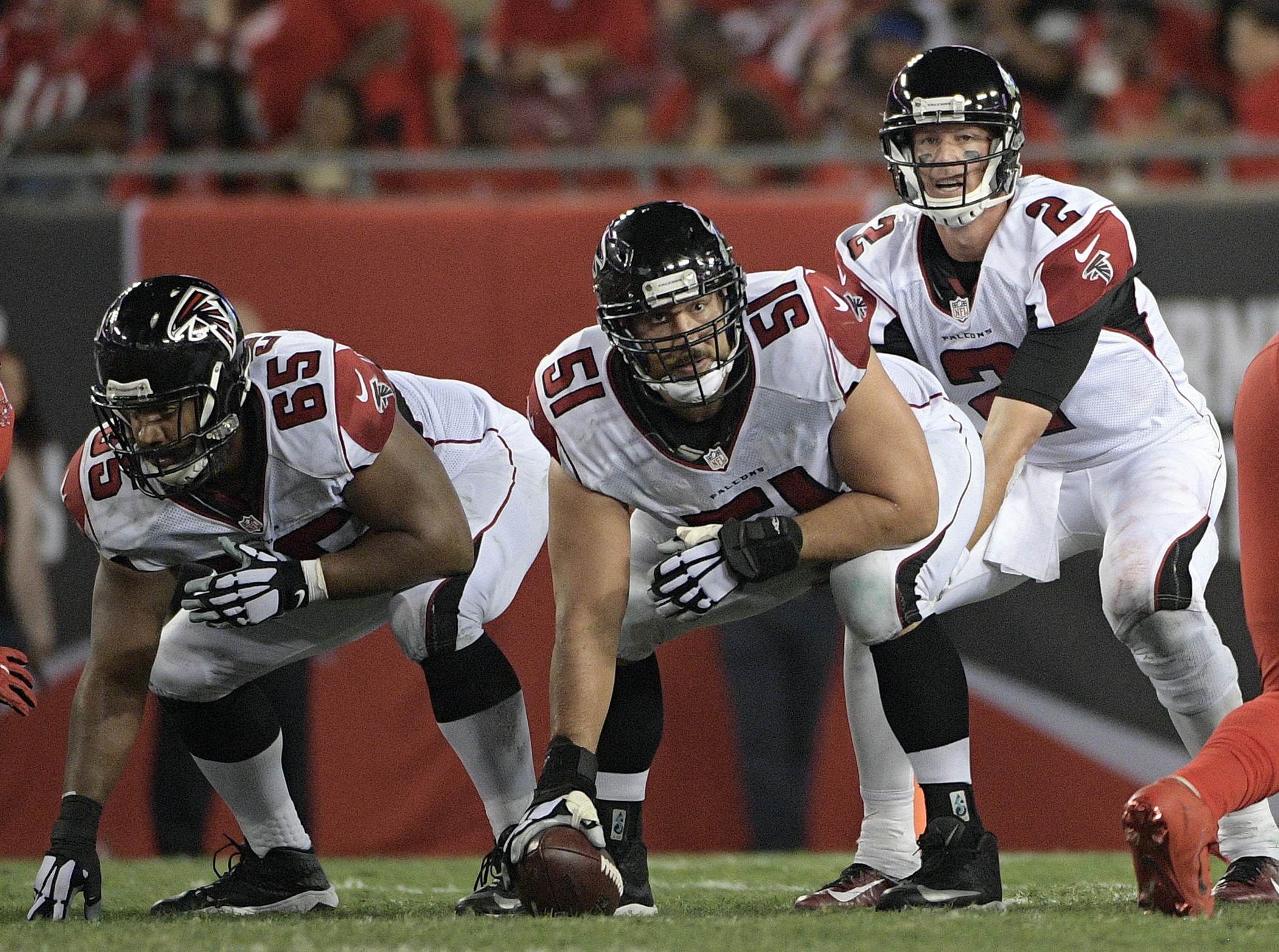 FILE - In this Nov. 3, 2016, file photo, Atlanta Falcons center Alex Mack (51) gets set to snap the ball to quarterback Matt Ryan (2)  during the second quarter of an NFL football game against the Tampa Bay Buccaneers in Tampa, Fla. The Falcons are deligh