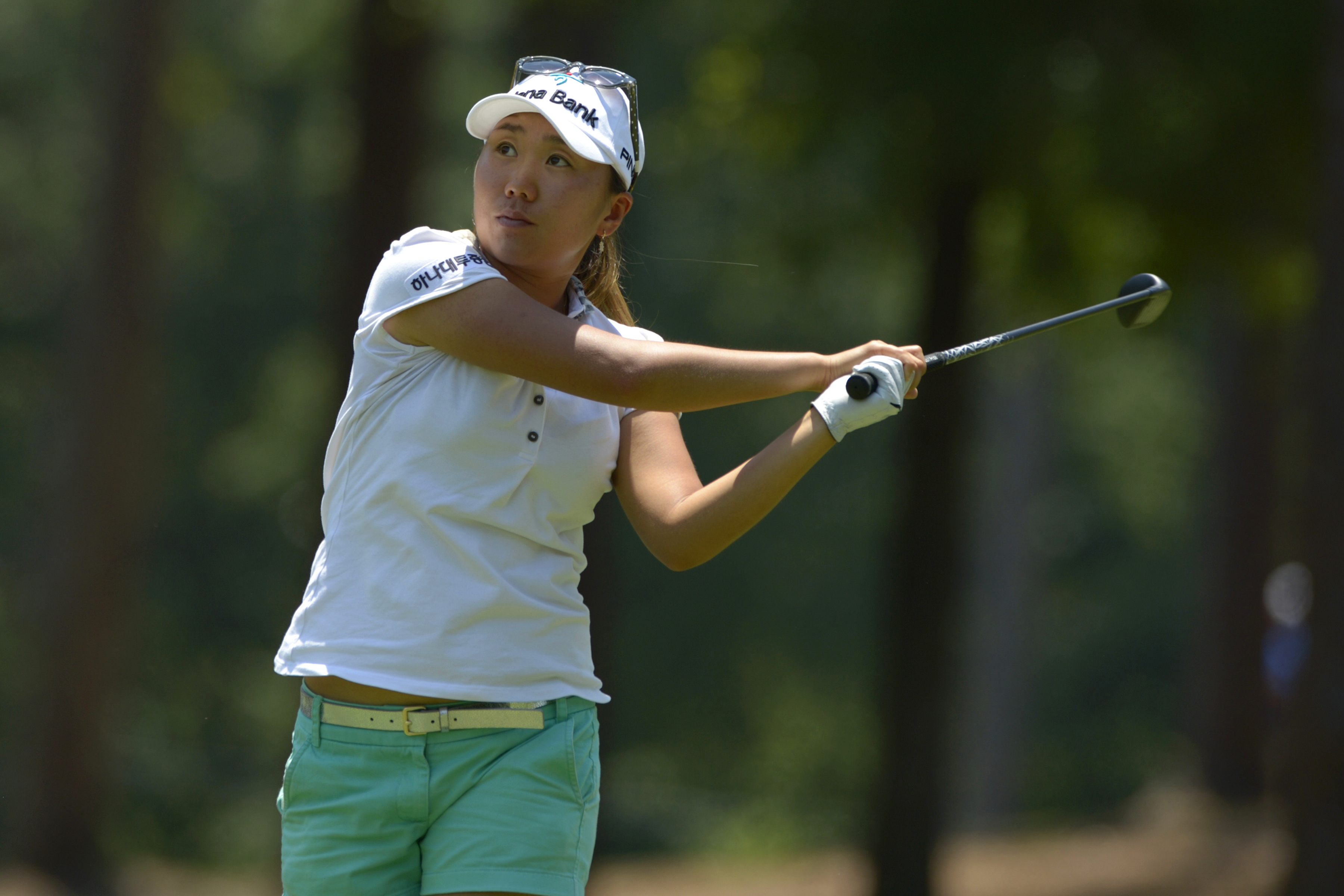 I.K. Kim of South Korea watches her tee shot on the eighth hole in the second round of the Airbus LPGA Classic golf tournament at Magnolia Grove on Friday, May 23, 2014, in Mobile, Ala. (AP Photo/G.M. Andrews)