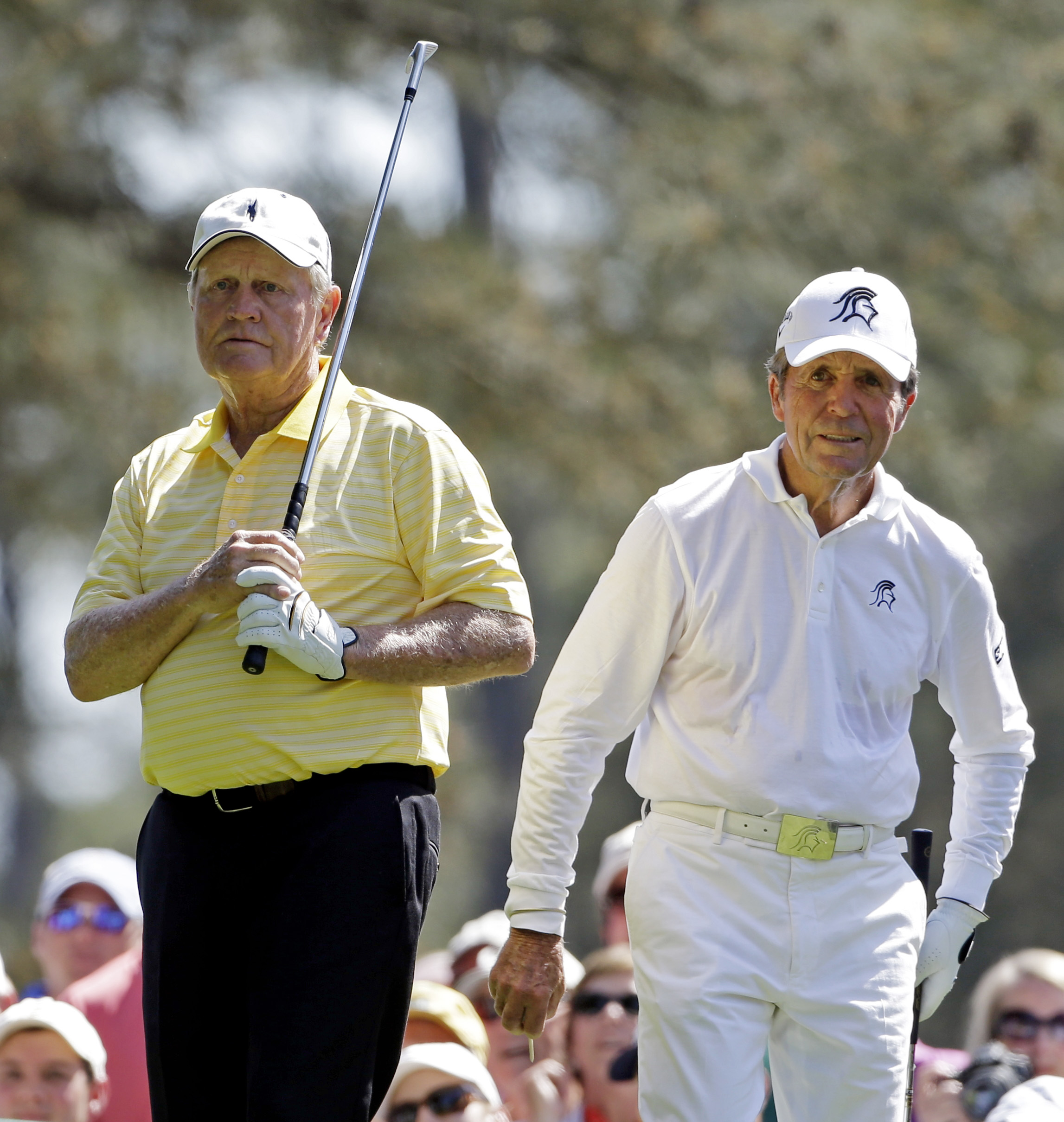 Gary Player, right, watches Jack Nicklaus' tee from the first hole during the par three competition before the Masters golf tournament Wednesday, April 10, 2013, in Augusta, Ga. (AP Photo/Darron Cummings)