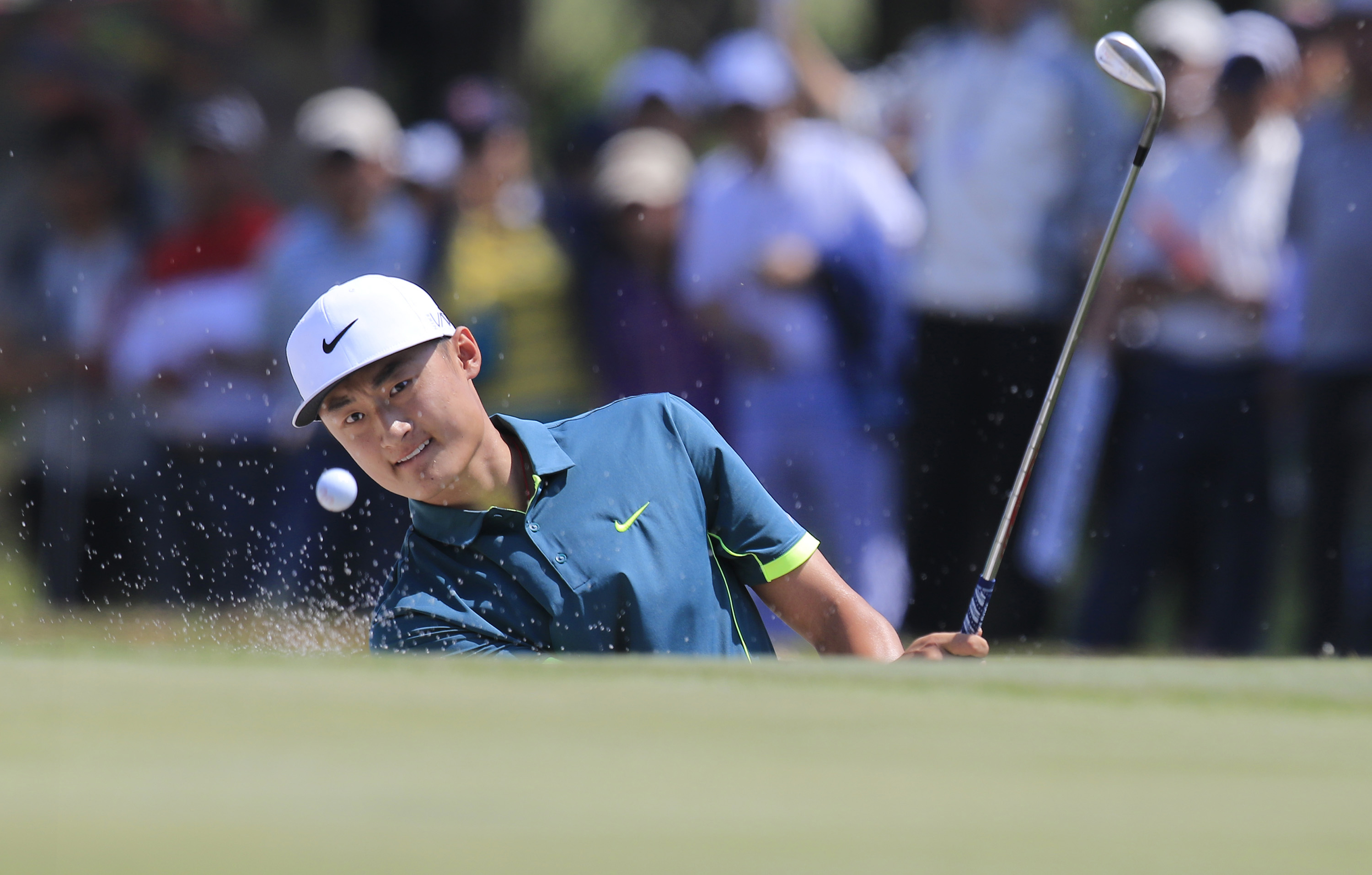 Li Haotong of China hits from a bunker on the 2nd hole during the final round of the Volvo China Open in Shanghai, China, Sunday, April 26, 2015. (AP Photo)