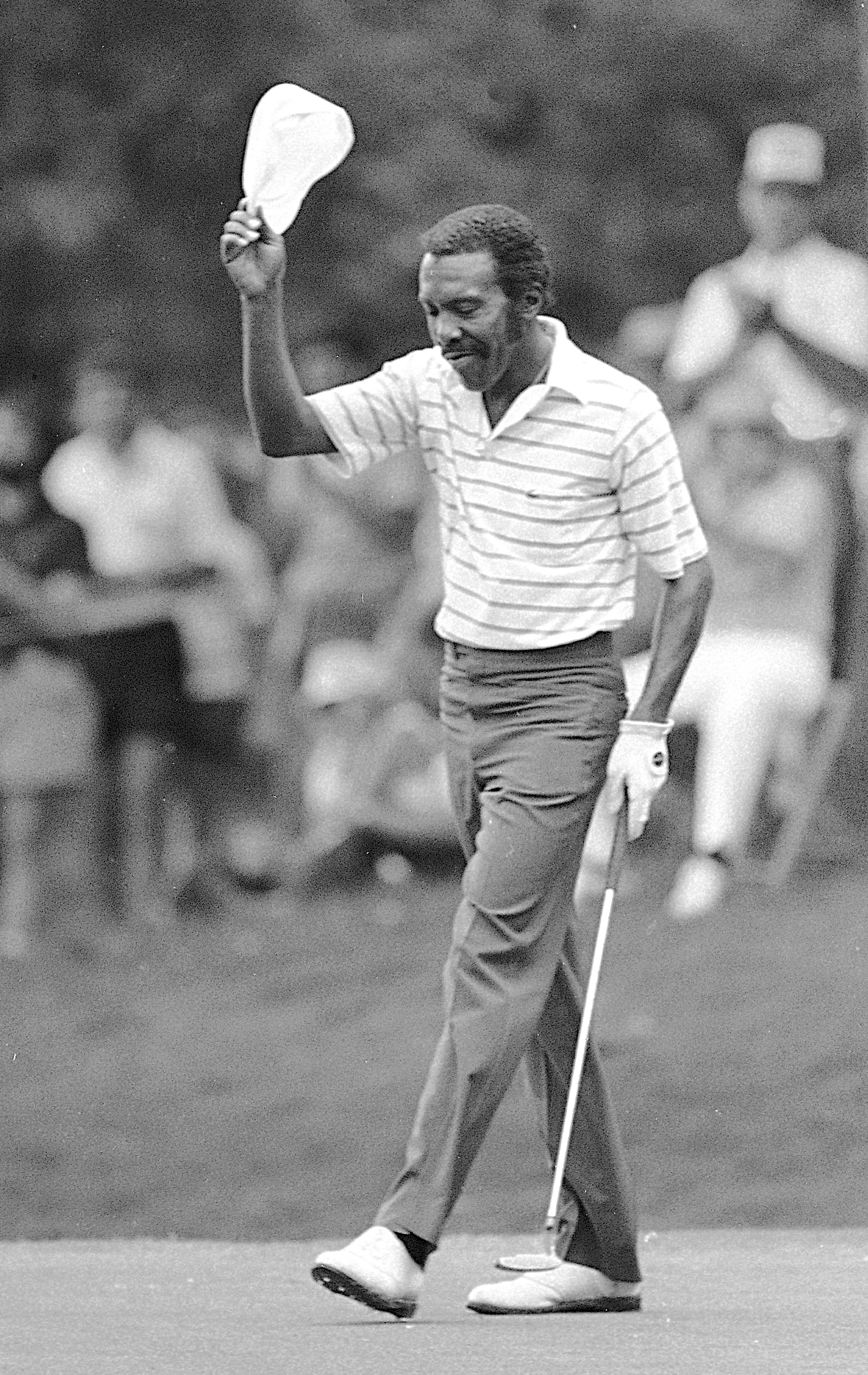 FILE - In this May 22, 1983, file photo, Calvin Peete tips his cap as the gallery gives him a standing ovation after he made a birdie on the 18th hole to win the Pacific-Atlanta Classic golf tournament in Atlanta. Peete, the most successful black player o