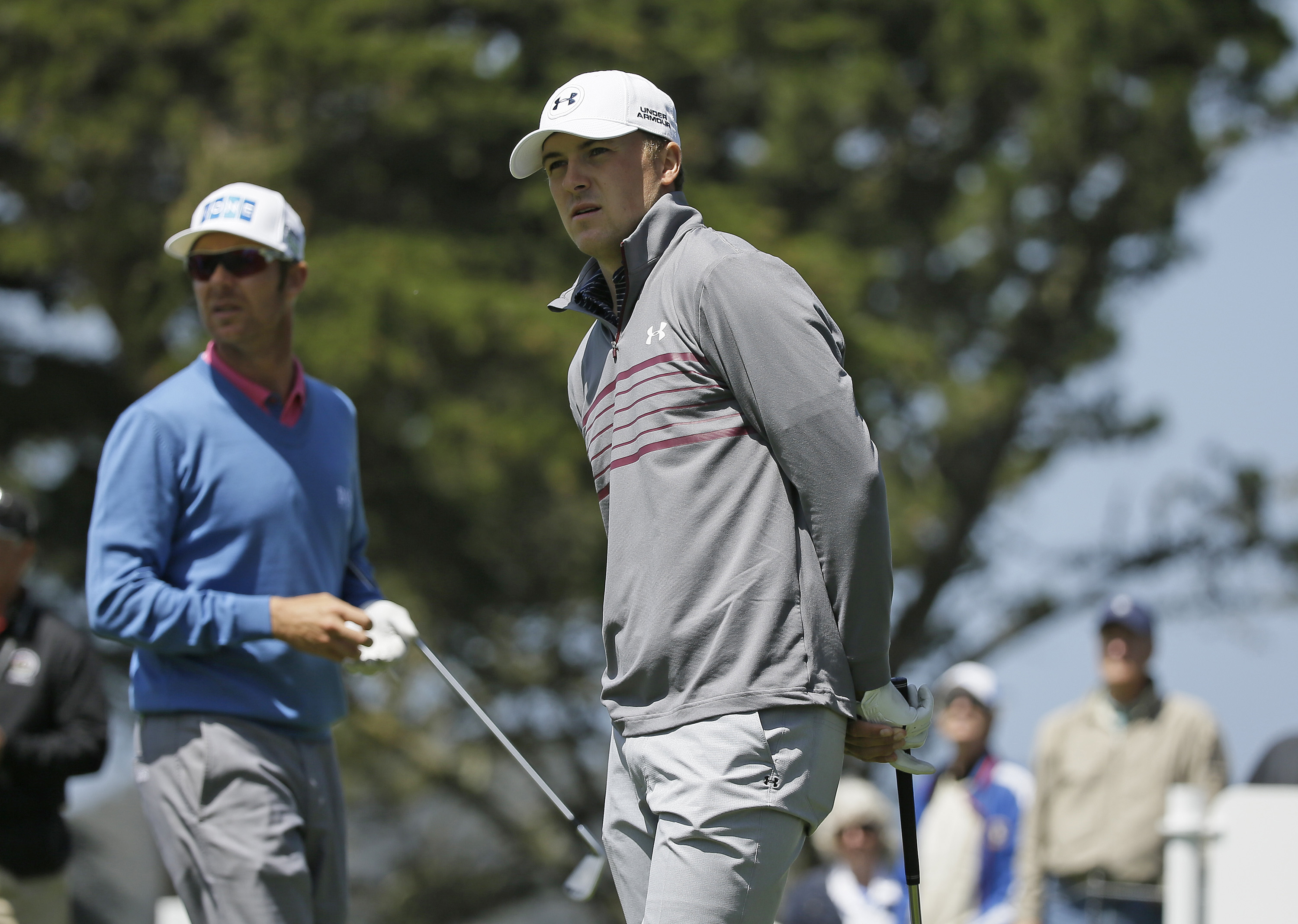 Jordan Spieth, right, follows his shot from the second tee of TPC Harding Park during round-robin play against Mikko Ilonen, left, of Finland at the Match Play Championship golf tournament Wednesday, April 29, 2015, in San Francisco. (AP Photo/Eric Risber