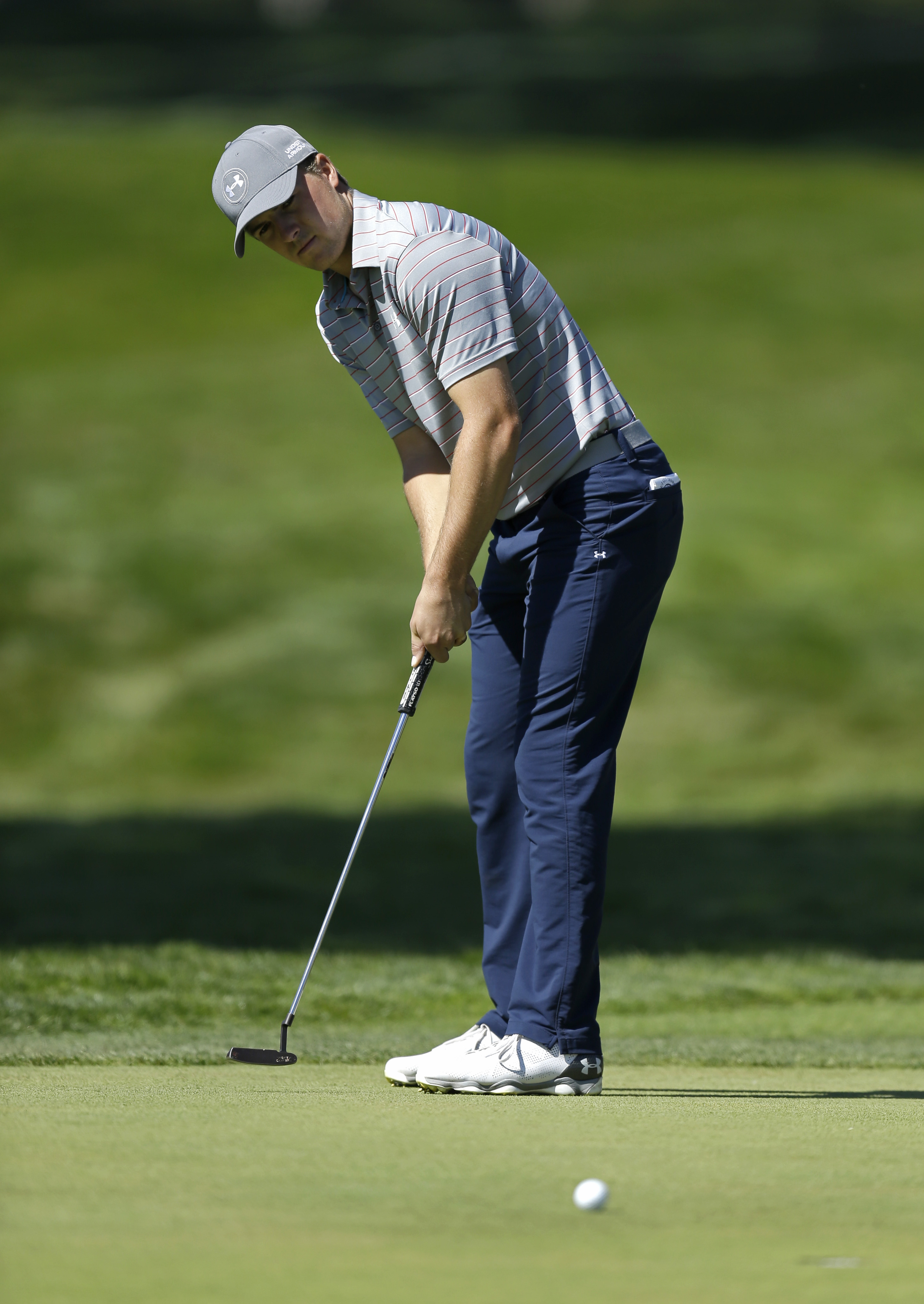 Jordan Spieth follows his shot on the fourth green of TPC Harding Park during round-robin play against Henrik Stenson, of Sweden, at the Match Play Championship golf tournament Thursday, April 30, 2015, in San Francisco. (AP Photo/Ben Margot)