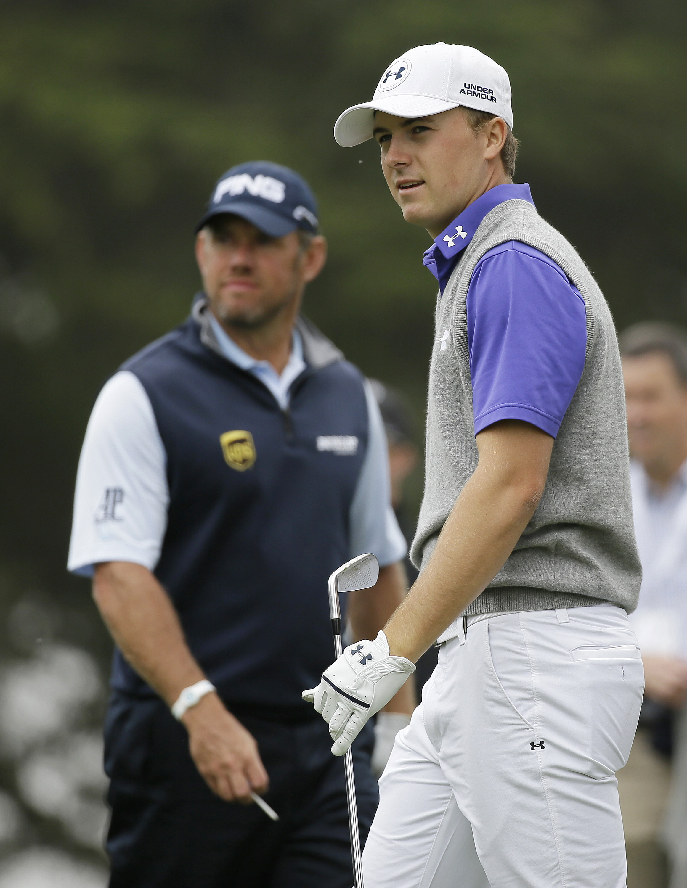 Jordan Spieth, right, follows his shot from the second tee of TPC Harding Park during round-robin play against Lee Westwood, left, of England, at the Match Play Championship golf tournament Friday, May 1, 2015, in San Francisco. (AP Photo/Eric Risberg)