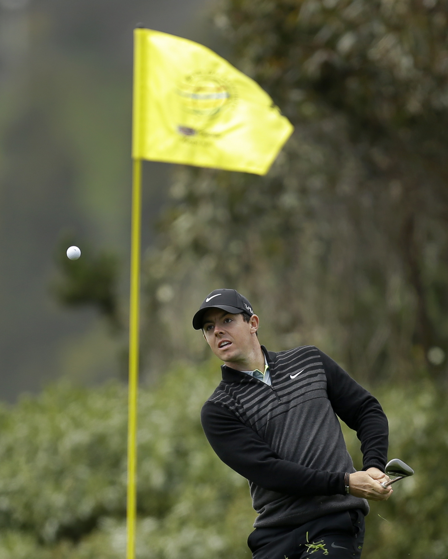 Rory McIlroy, of Northern Ireland, hits out of the rough on the 13th hole of the Match Play Championship golf tournament at TCP Harding Park on Sunday, May 3, 2015, in San Francisco. McIlroy won the tournament. (AP Photo/Ben Margot)