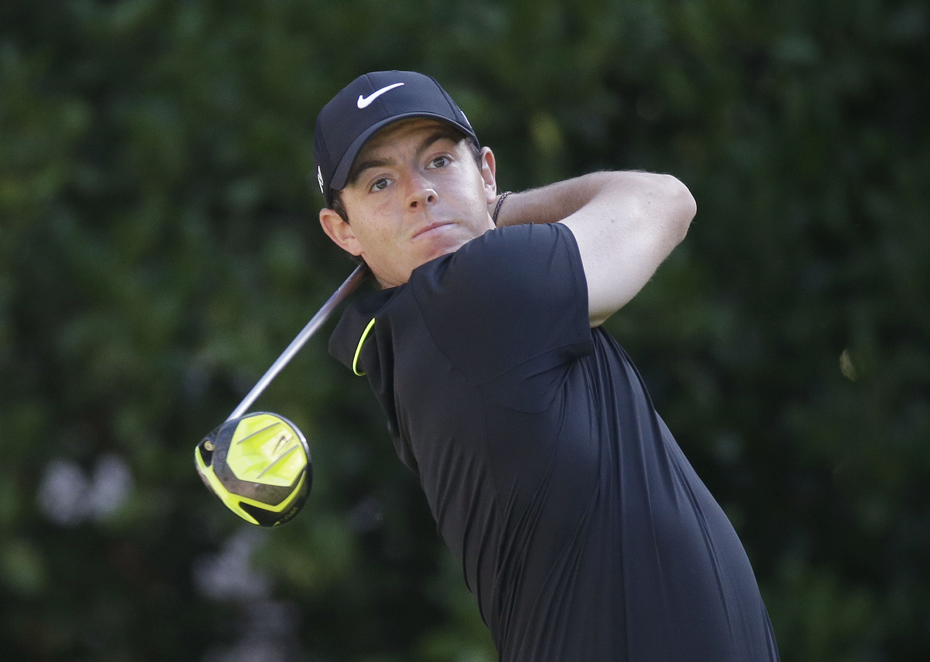 Rory McIlroy, of Northern Ireland, hits from the 10th tee during the first round of The Players Championship golf tournament Thursday, May 7, 2015, in Ponte Vedra Beach, Fla., Fla. (AP Photo/John Raoux)