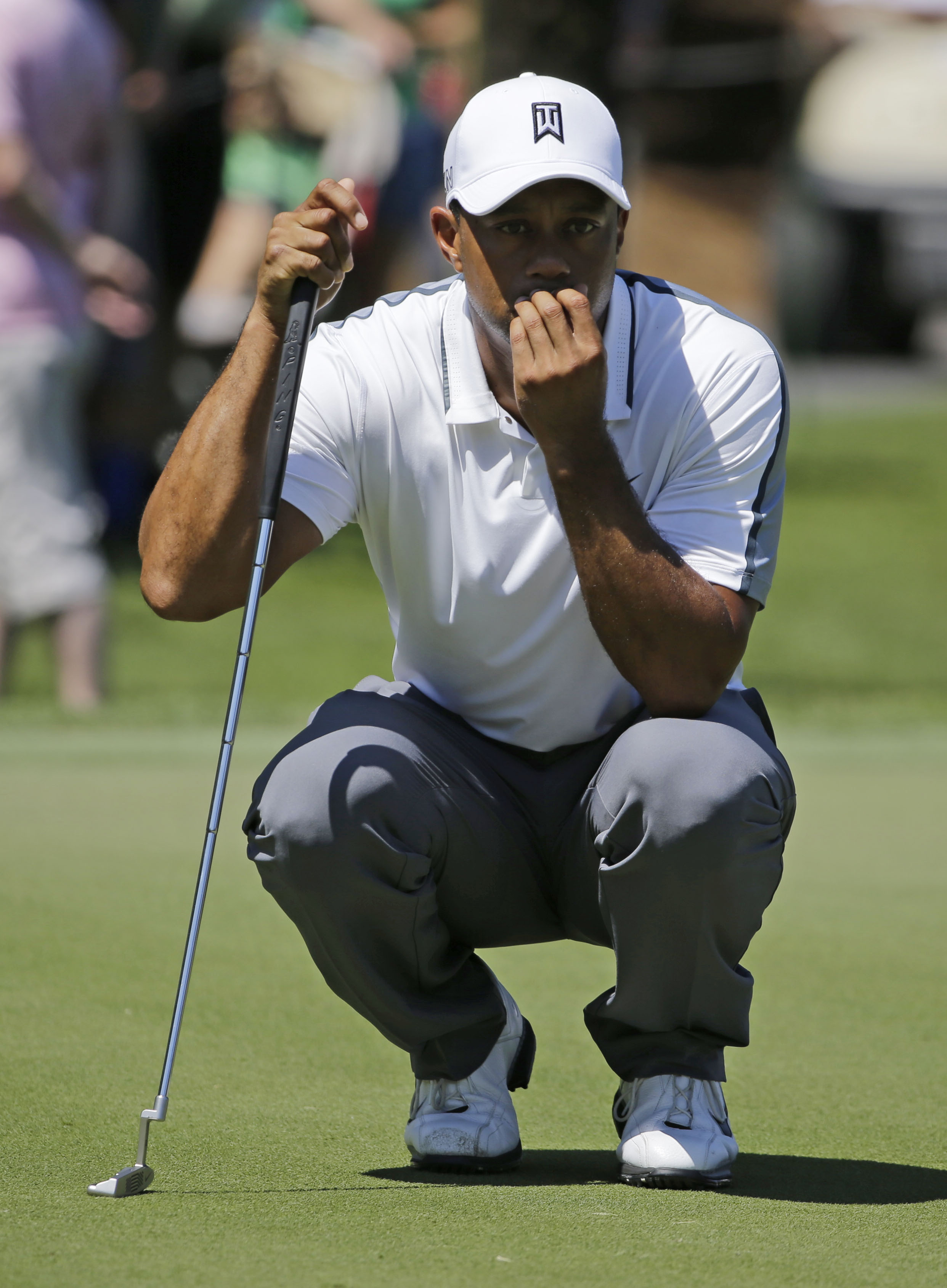 Tiger Woods looks at his shot on the sixth green during the first round of The Players Championship golf tournament Thursday, May 7, 2015, in Ponte Vedra Beach, Fla., Fla. (AP Photo/Chris O'Meara)