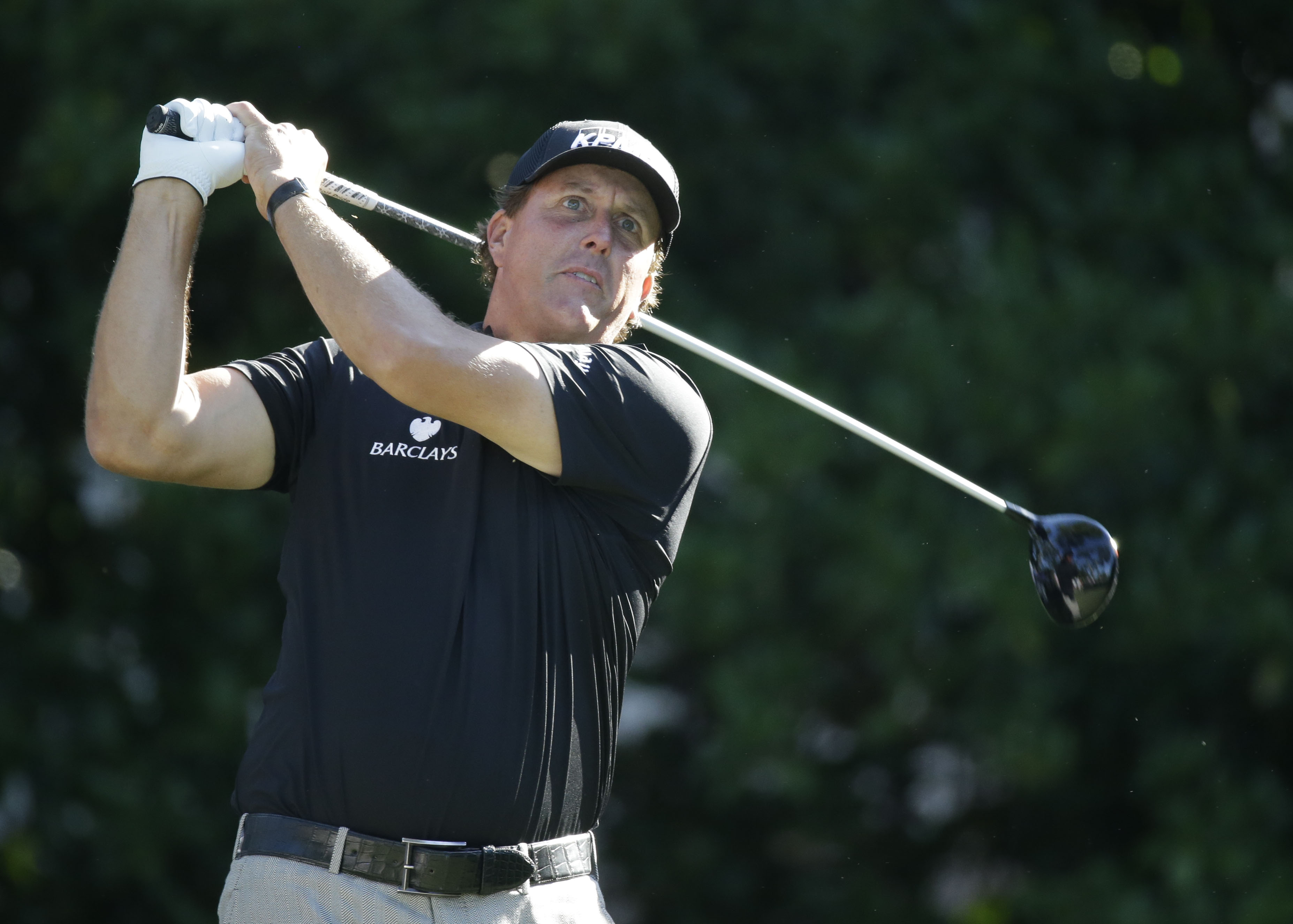 Phil Mickelson hits from the 11th tee during the second round of The Players Championship golf tournament Friday, May 8, 2015, in Ponte Vedra Beach, Fla. (AP Photo/John Raoux)