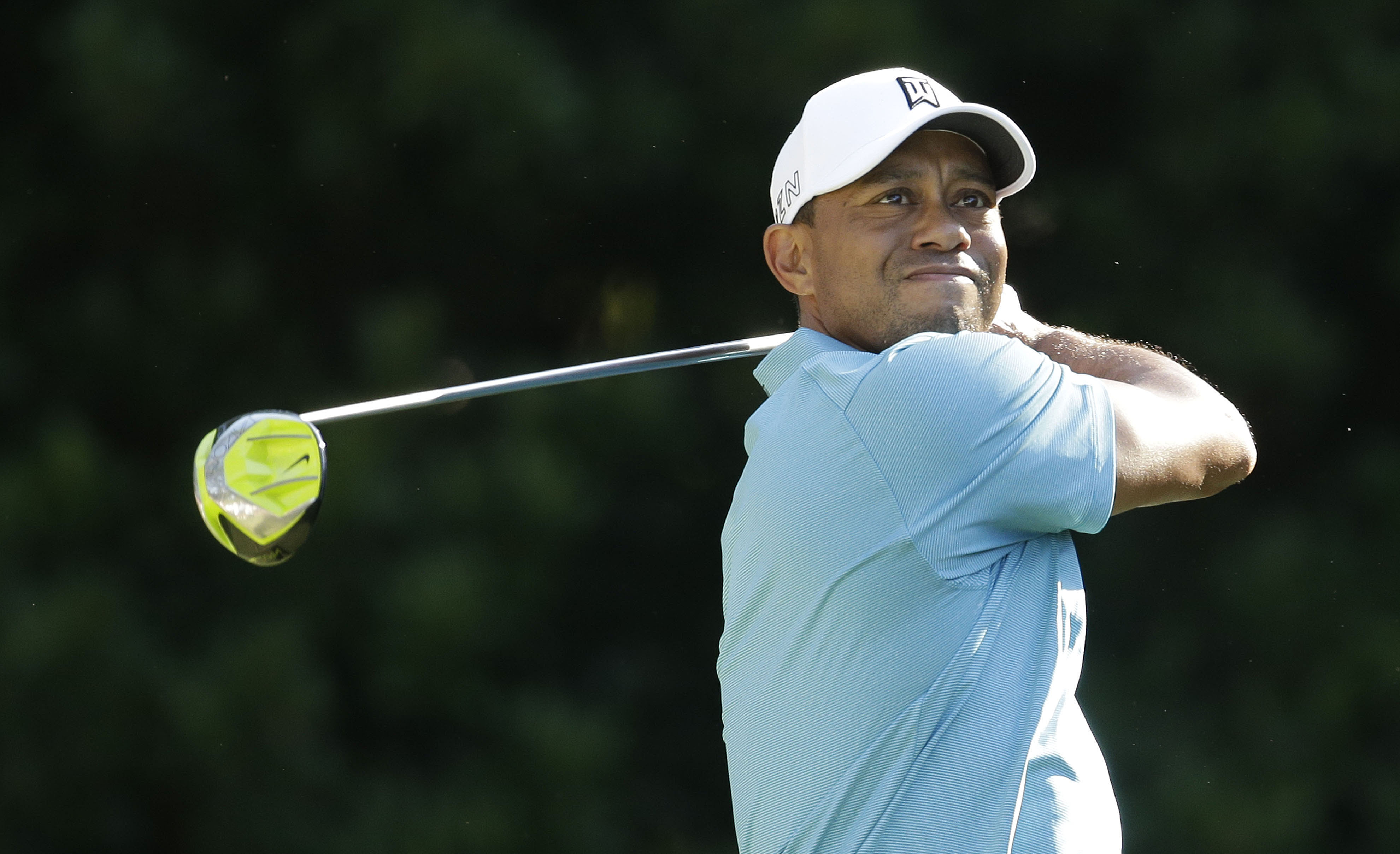 Tiger Woods follows his shot from the 11th tee during the second round of The Players Championship golf tournament Friday, May 8, 2015, in Ponte Vedra Beach, Fla. (AP Photo/Lynne Sladky)