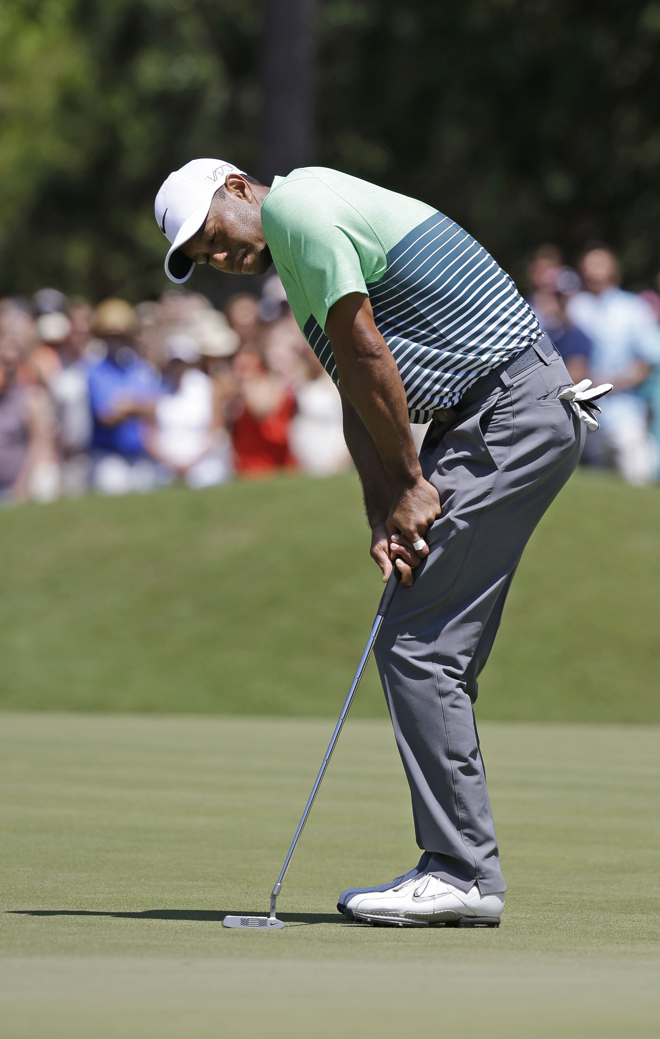 Tiger Woods reacts after missing a birdie putt on the 14th hole during the third round of The Players Championship golf tournament Saturday, May 9, 2015, in Ponte Vedra Beach, Fla. (AP Photo/John Raoux)