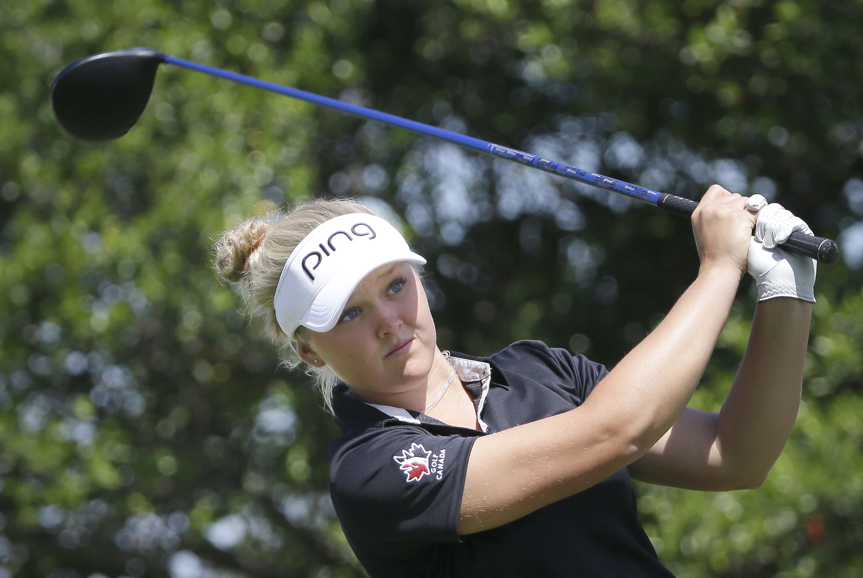 Brooke Henderson watches her tee shot on the second hole during the final round of the LPGA North Texas Shootout golf tournament, Sunday, May 3, 2015, in Irving, Texas. (AP Photo/LM Otero)