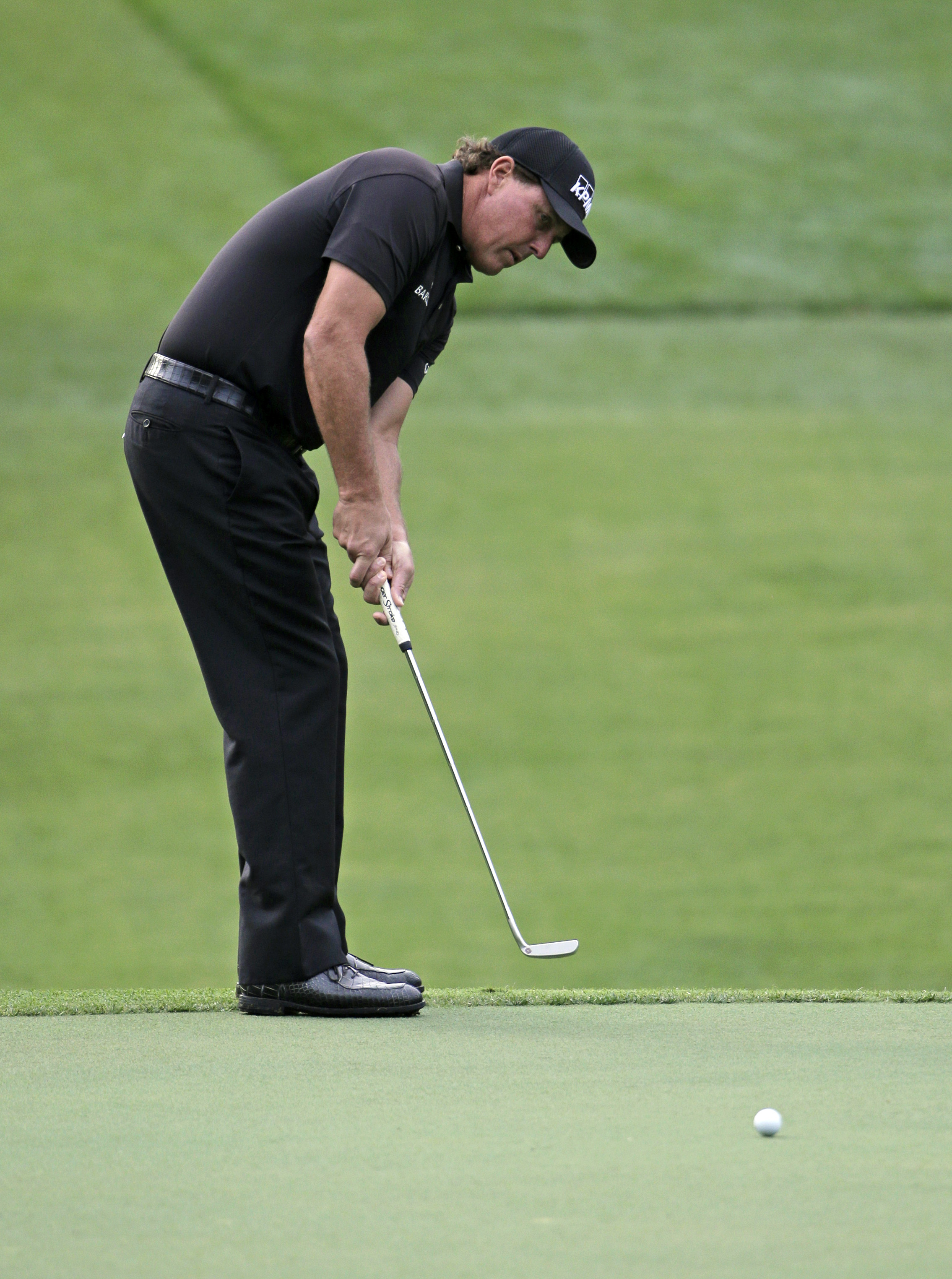 Phil Mickelson watches his putt on the second hole during the pro-am for the Wells Fargo Championship golf tournament at the Quail Hollow Club in Charlotte, N.C., Wednesday, May 13, 2015. (AP Photo/Chuck Burton)