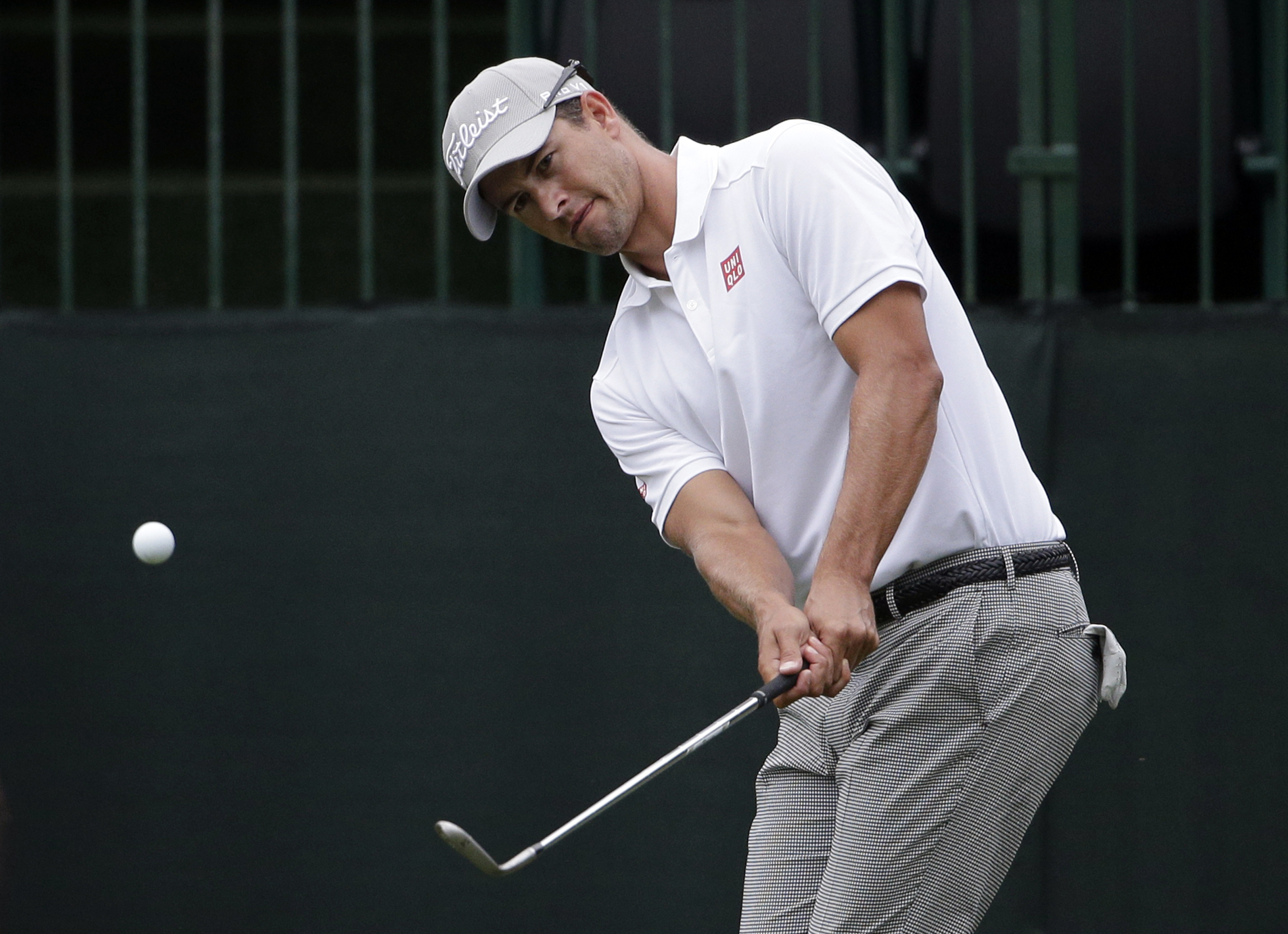 Adam Scott, of Australia, chips to the 10th green during the second round of the Wells Fargo Championship golf tournament at Quail Hollow Club in Charlotte, N.C., Friday, May 15, 2015. (AP Photo/Chuck Burton)