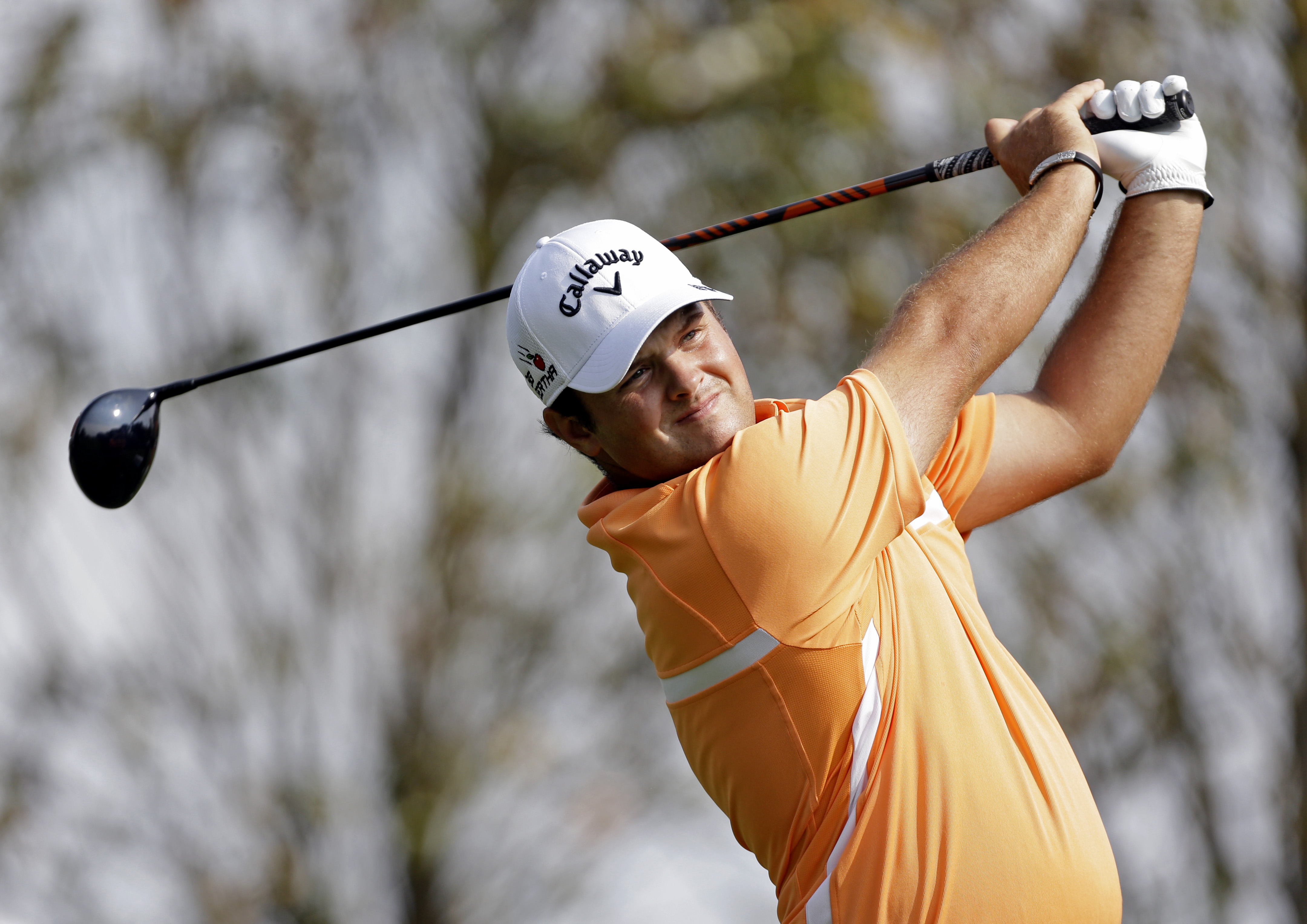 Patrick Reed watches his tee shot on the 16th hole during the second round of the Wells Fargo Championship golf tournament at Quail Hollow Club in Charlotte, N.C., Friday, May 15, 2015. (AP Photo/Bob Leverone)