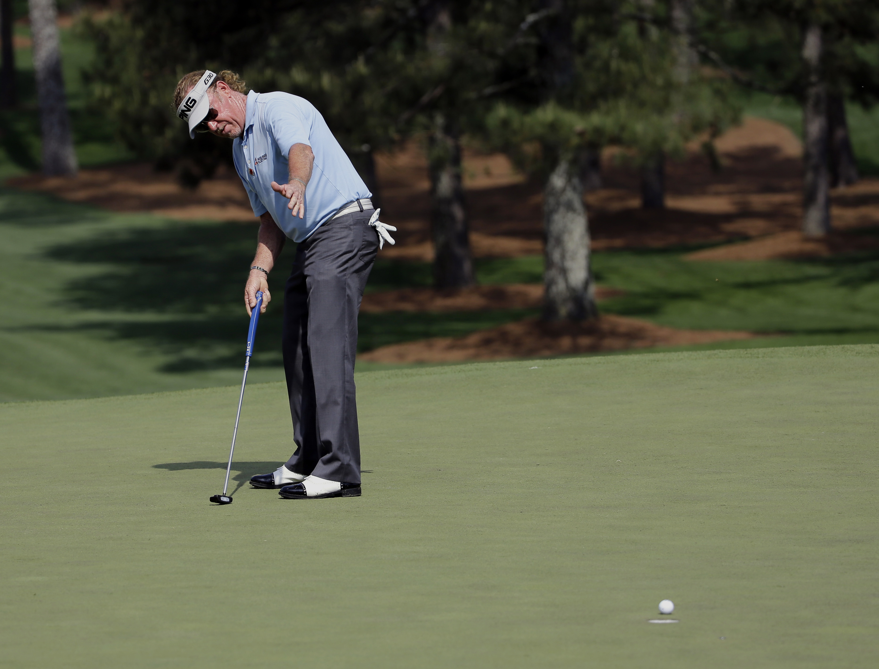 Miguel Angel Jimenez, of Spain, reacts to a missed birdie on the seventh green during the first round of the Masters golf tournament Thursday, April 9, 2015, in Augusta, Ga. (AP Photo/David J. Phillip)