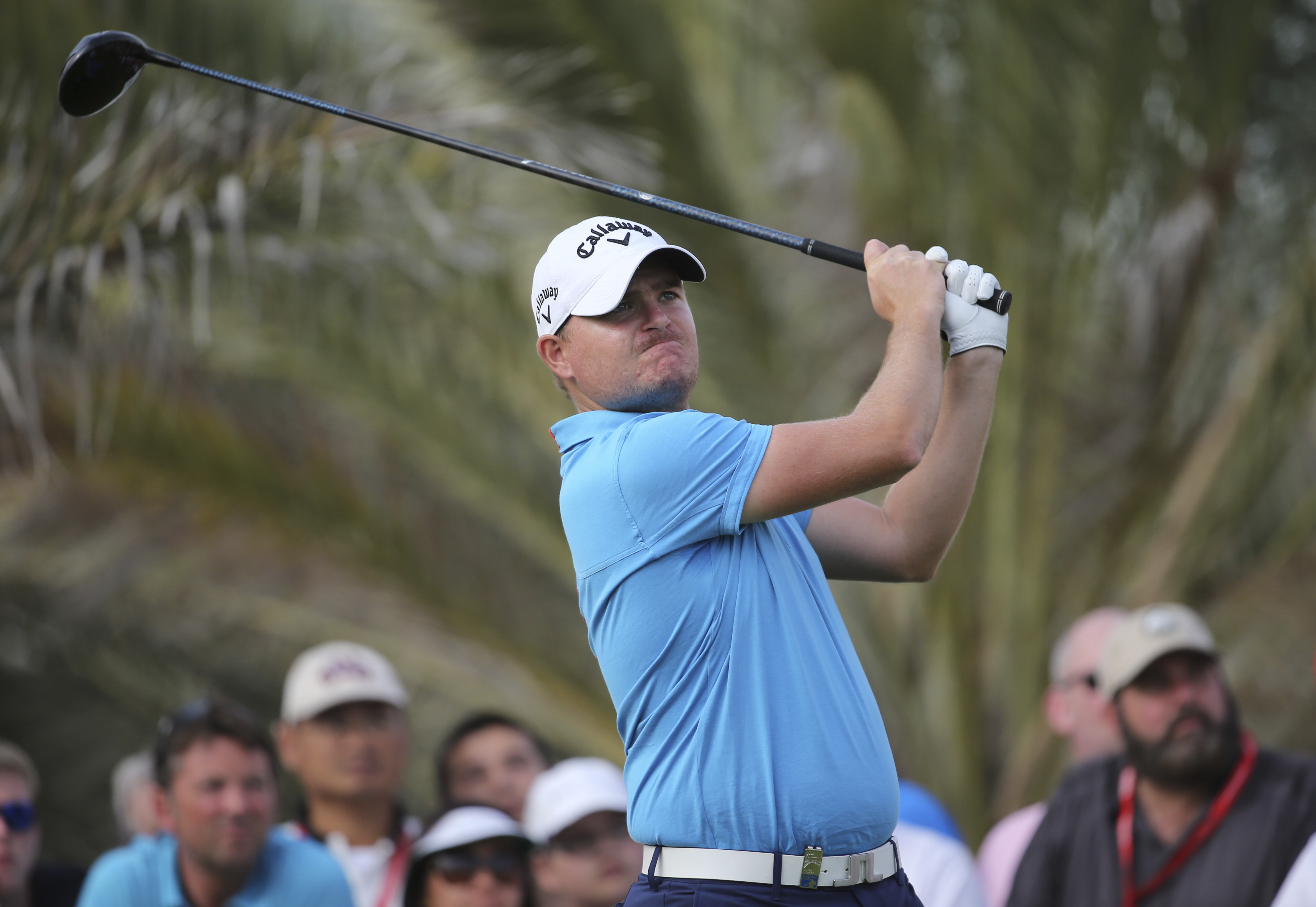 James Morrison of England tees off on the 14th hole during the third round of the HSBC Golf Championship in Abu Dhabi, United Arab Emirates, Saturday, Jan. 17, 2015. (AP Photo/Kamran Jebreili)