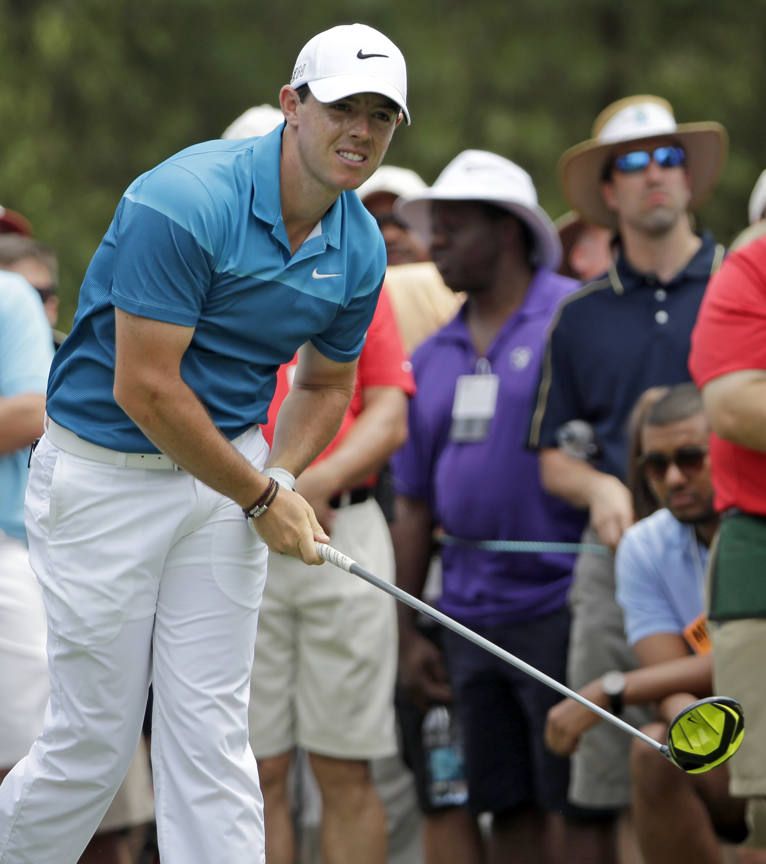 Rory McIlroy, of Northern Ireland, watches his tee shot on the fourth hole during the final round of the Wells Fargo Championship golf tournament at Quail Hollow Club in Charlotte, N.C., Sunday, May 17, 2015. (AP Photo/Chuck Burton)