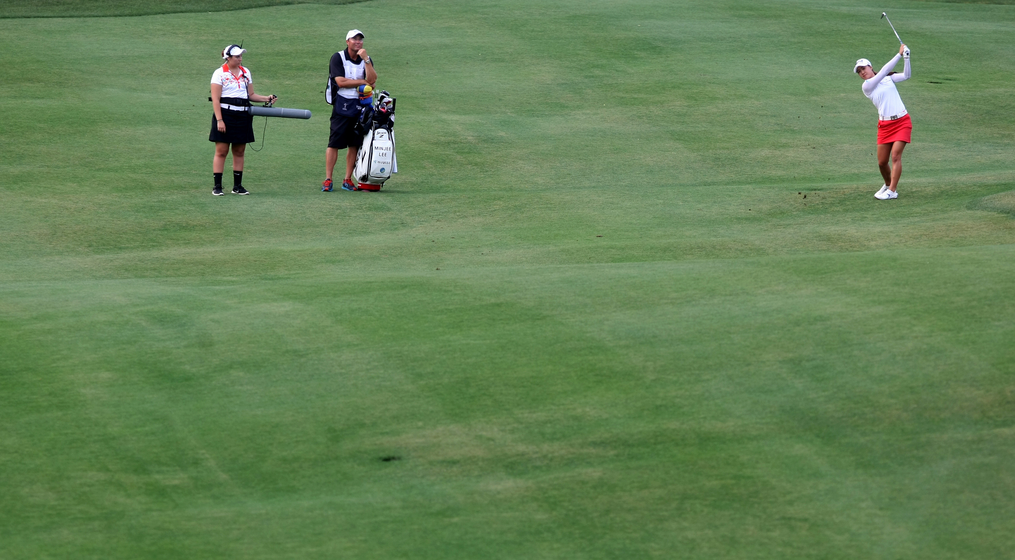 Minjee Lee, right, hits an approach shot on the eighth fairway during the final round of the LPGA Tour's Kingsmill Championship golf tournament on Sunday, May 17, 2015, in Williamsburg, Va. (AP Photo/Jason Hirschfeld)