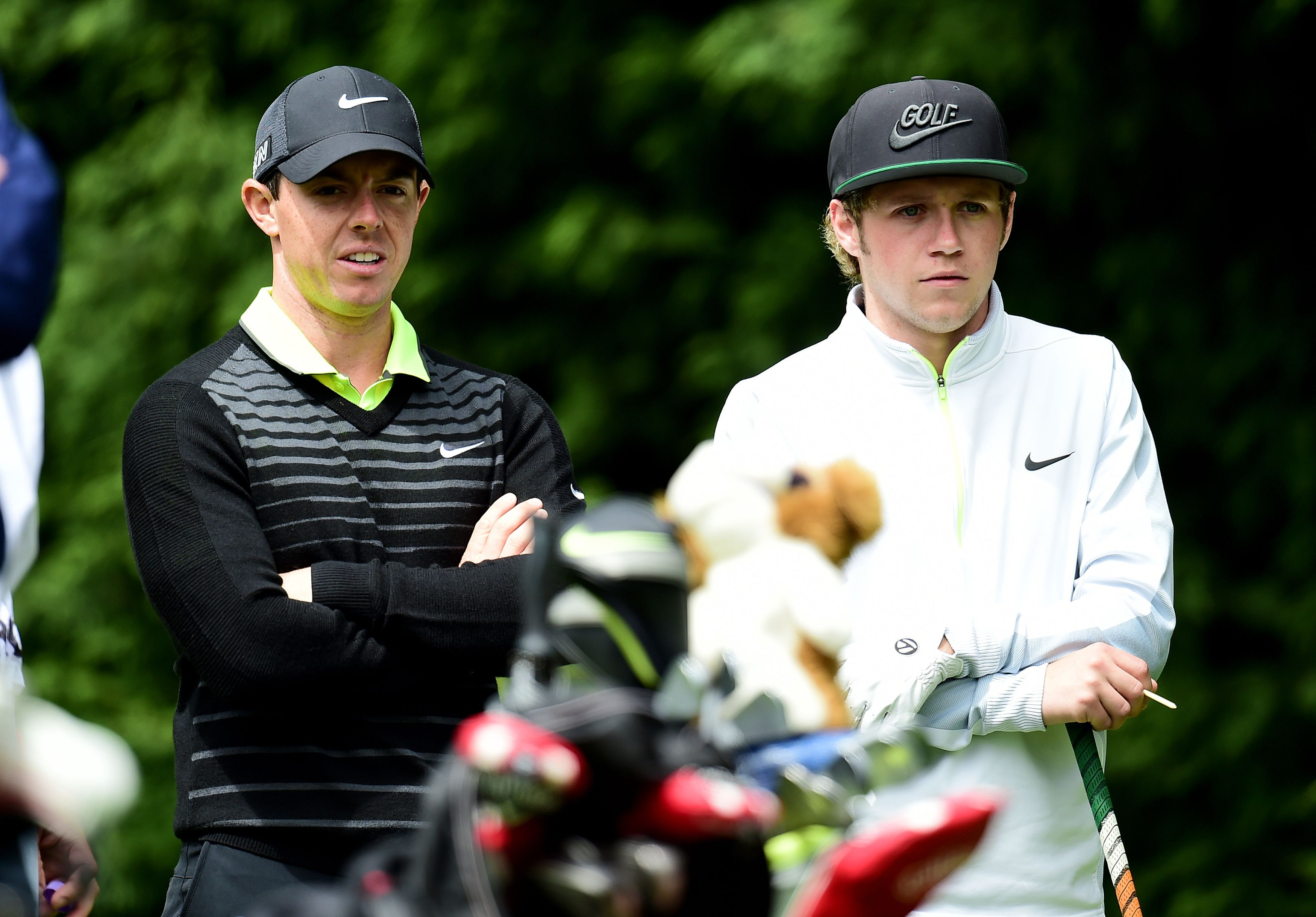 Northern Ireland's Rory McIlroy, right, plays with Niall Horan from One Direction during the Pro-Am at the 2015 BMW PGA Championship at the Wentworth Golf Club, Surrey, England, Wednesday, May 20, 2015. (Adam Davy/PA via AP)     UNITED KINGDOM OUT     -