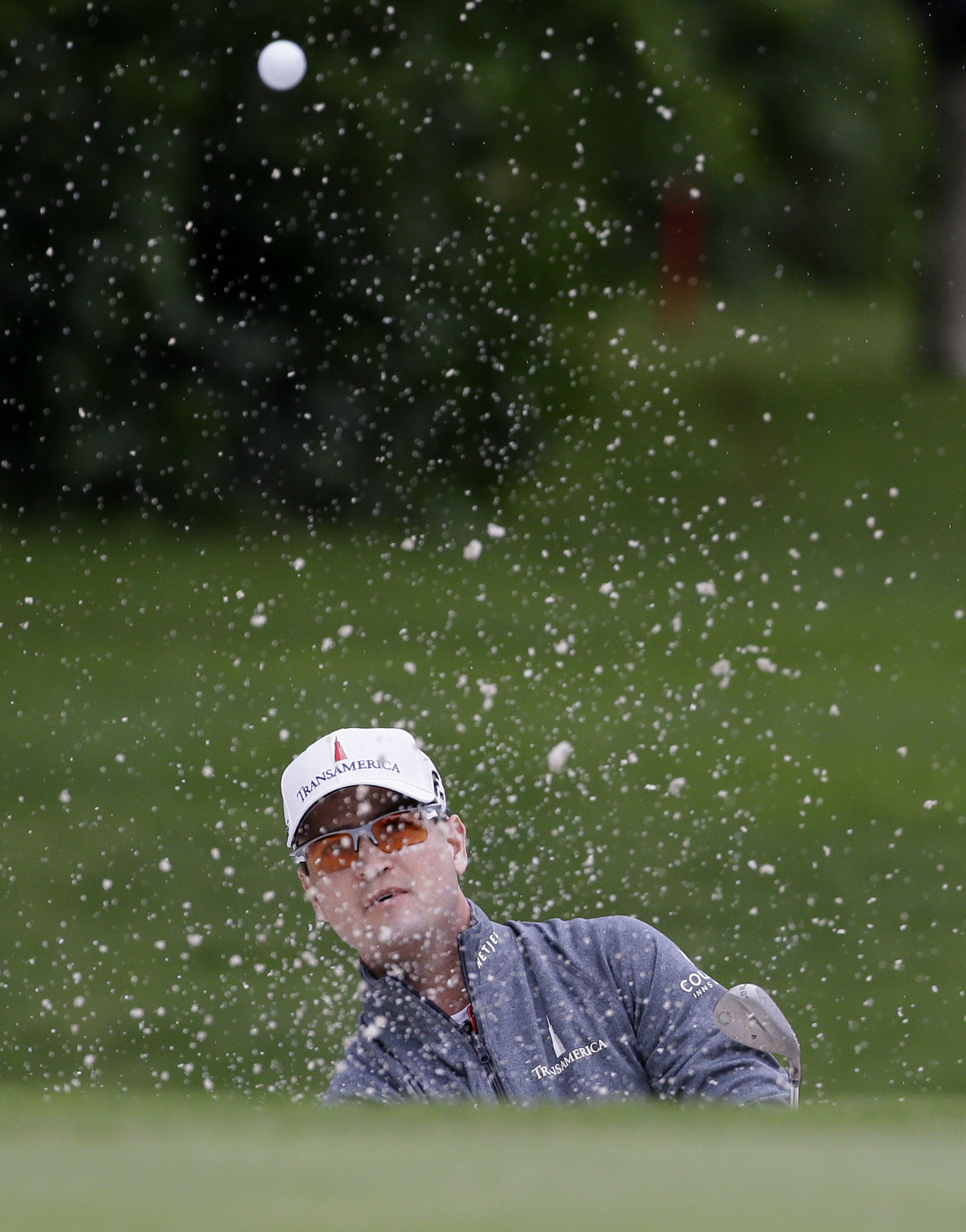 Zach Johnson hits from a sand trap on the 11th hole during the first round of the Colonial golf tournament, Thursday, May 21, 2015, in Fort Worth, Texas. (AP Photo/LM Otero)