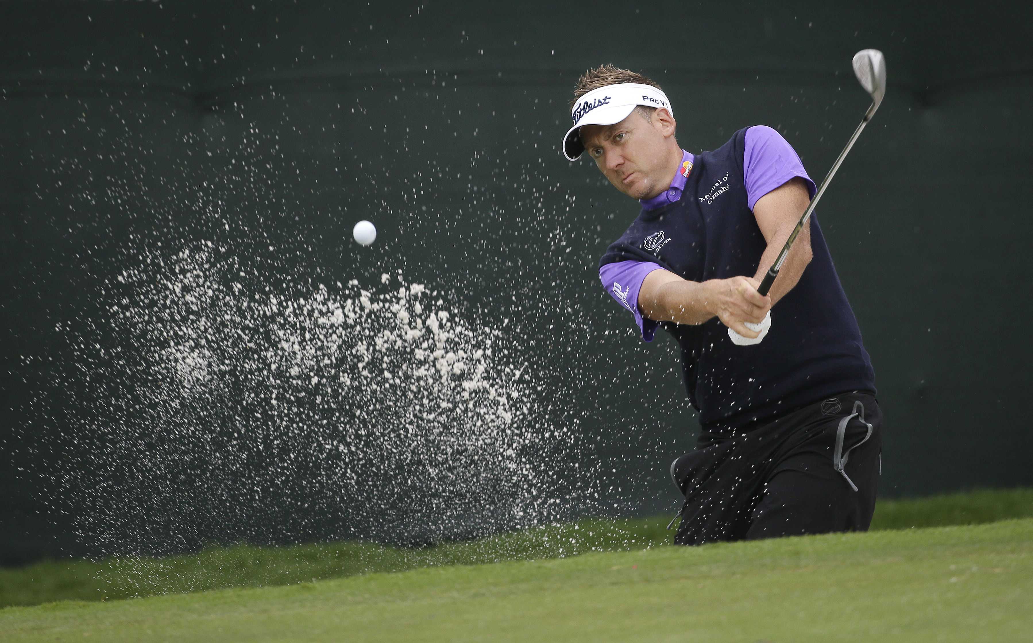 Ian Poulter hits from the sand on the ninth hole during the second round of the Colonial golf tournament, Friday, May 22, 2015, in Fort Worth, Texas. (AP Photo/LM Otero)
