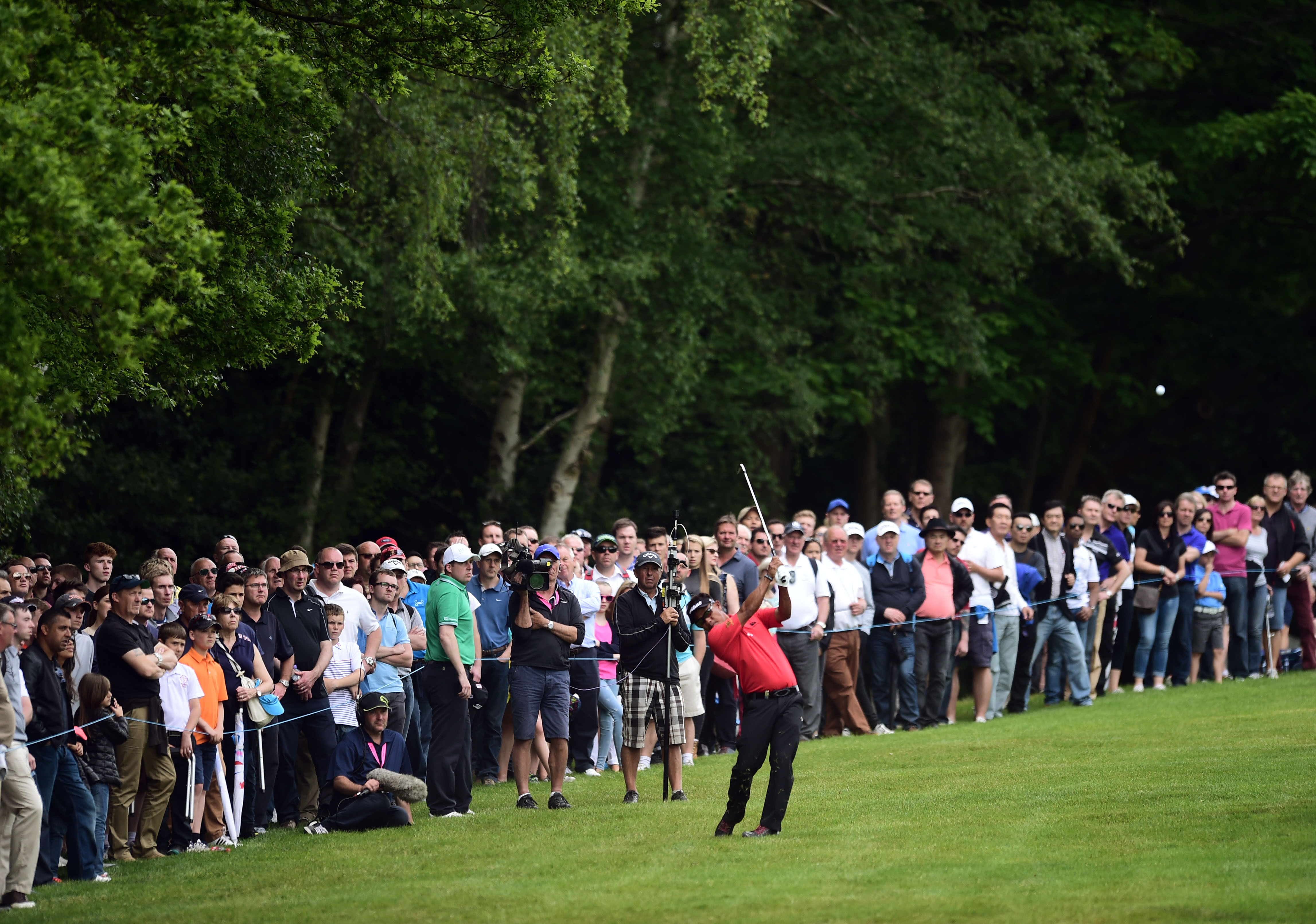 Thailand's Thongchai Jaidee makes a shot,  during day four of the 2015 BMW PGA Championship,  at the Wentworth golf club, in Virginia Water, England, Sunday May 24, 2015. (Adam Davy/PA via AP) UNITED KINGDOM OUT NO SALES NO ARCHIVE