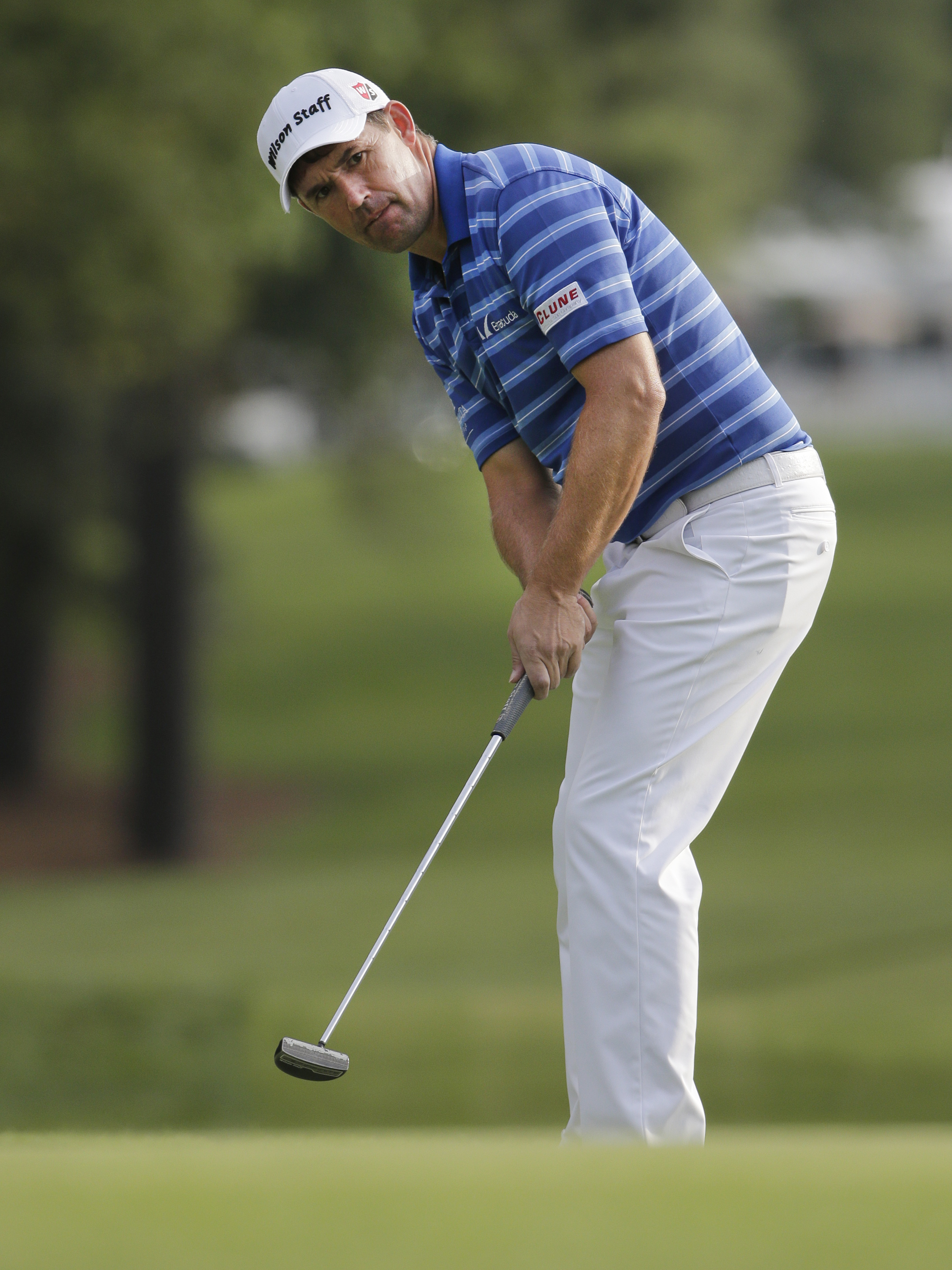Padraig Harrington, of Ireland, watches his putt on the first hole during the first round of the Wells Fargo Championship golf tournament at Quail Hollow Club in Charlotte, N.C., Thursday, May 14, 2015. (AP Photo/Chuck Burton)